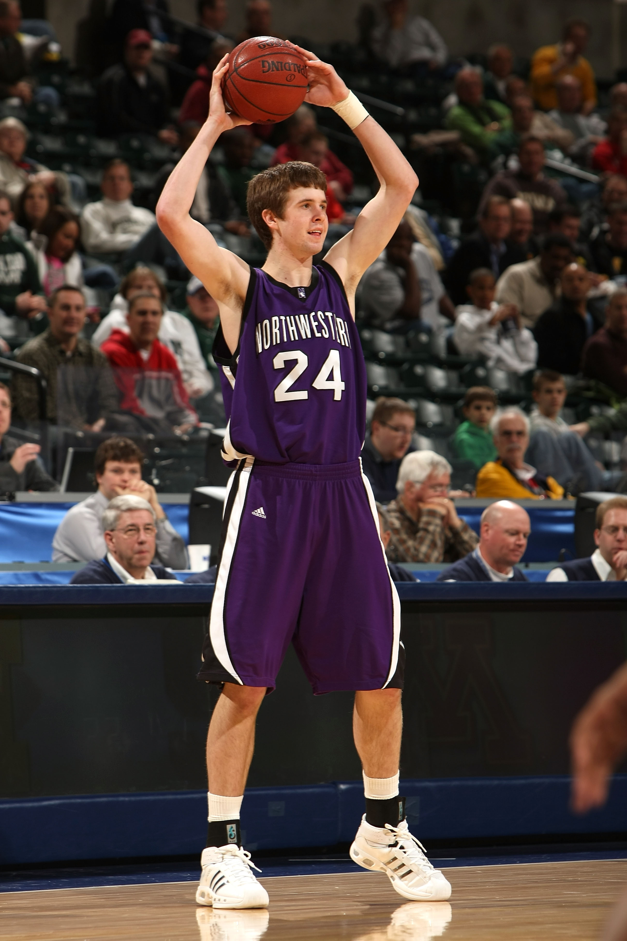 INDIANAPOLIS - MARCH 12:  John Shurna #24 of the Northwestern Wildcats looks to pass the ball against the Minnesota Golden Gophers during the first round of the Big Ten Men's Basketball Tournament at Conseco Fieldhouse on March 12, 2009 in Indianapolis, I