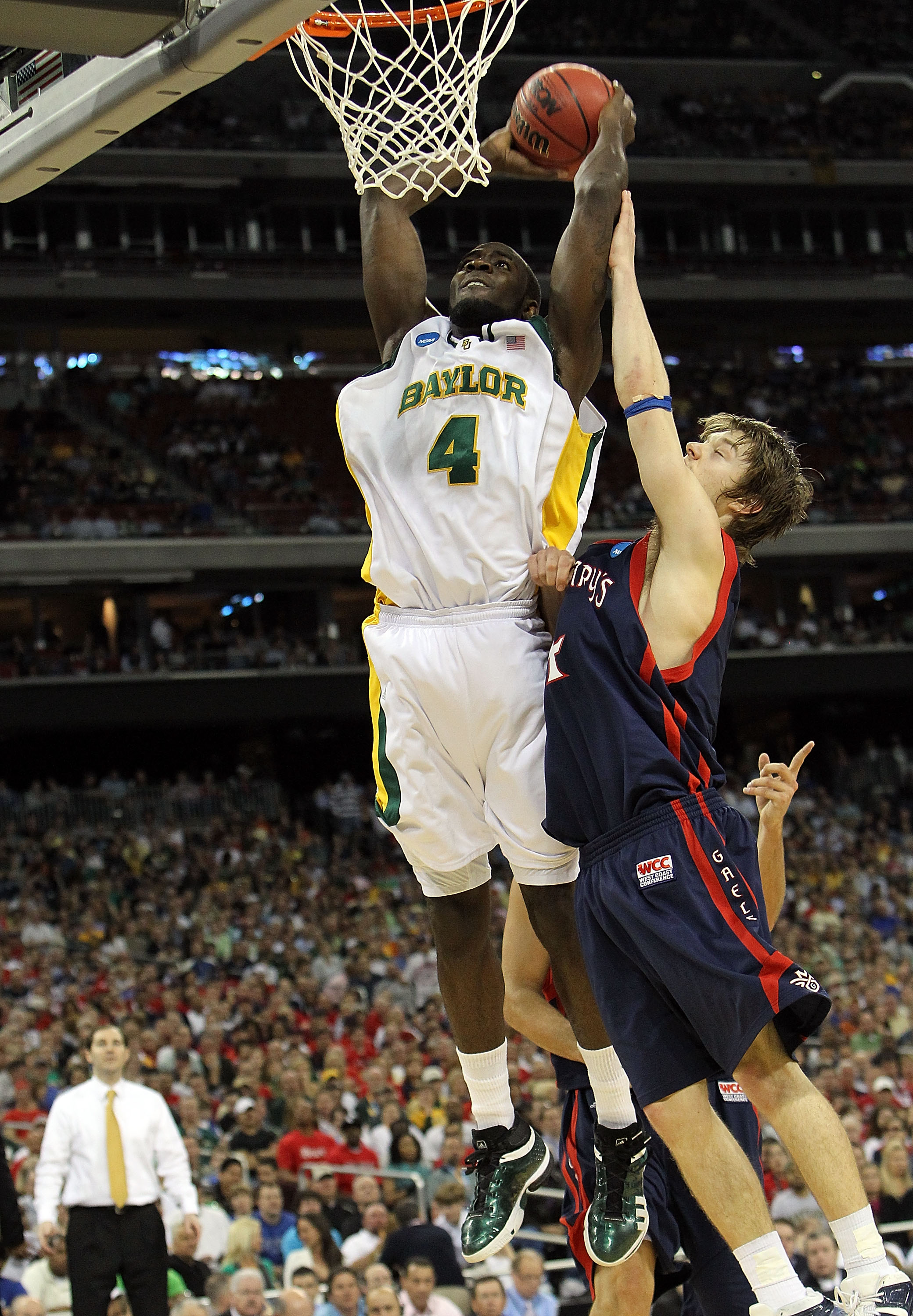 HOUSTON - MARCH 26:  Forward Quincy Acy #4 of the Baylor Bears makes a slam dunk against Matthew Dellavedova #4 of the St. Mary's Gaels during the south regional semifinal of the 2010 NCAA men's basketball tournament at Reliant Stadium on March 26, 2010 i