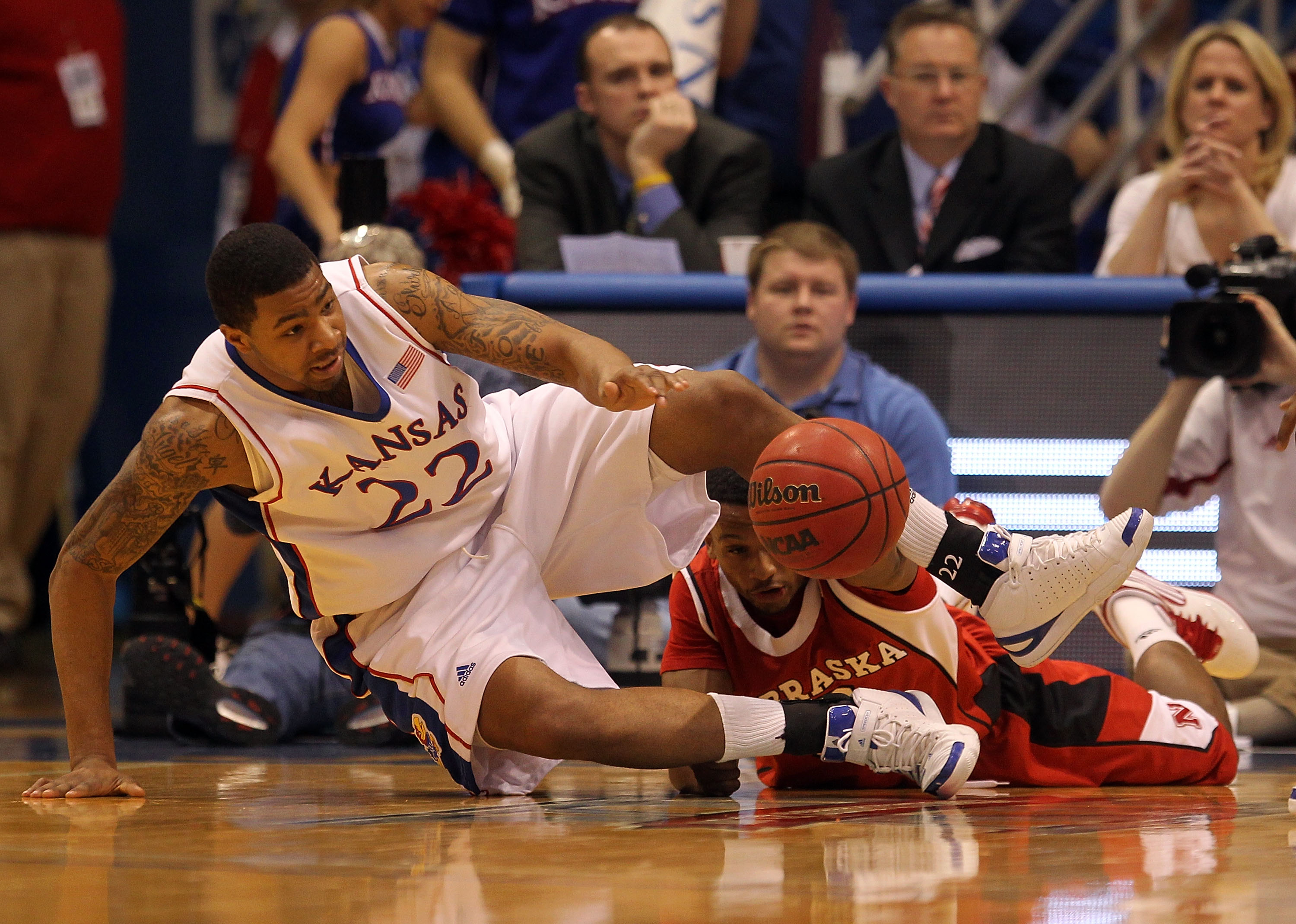 LAWRENCE, KS - FEBRUARY 06:  Marcus Morris #22 of the Kansas Jayhawks and Brandon Richardson #3 of the Nebraska Cornhuskers scramble for a loose ball during the game on February 6, 2010 at Allen Fieldhouse in Lawrence, Kansas.  (Photo by Jamie Squire/Gett