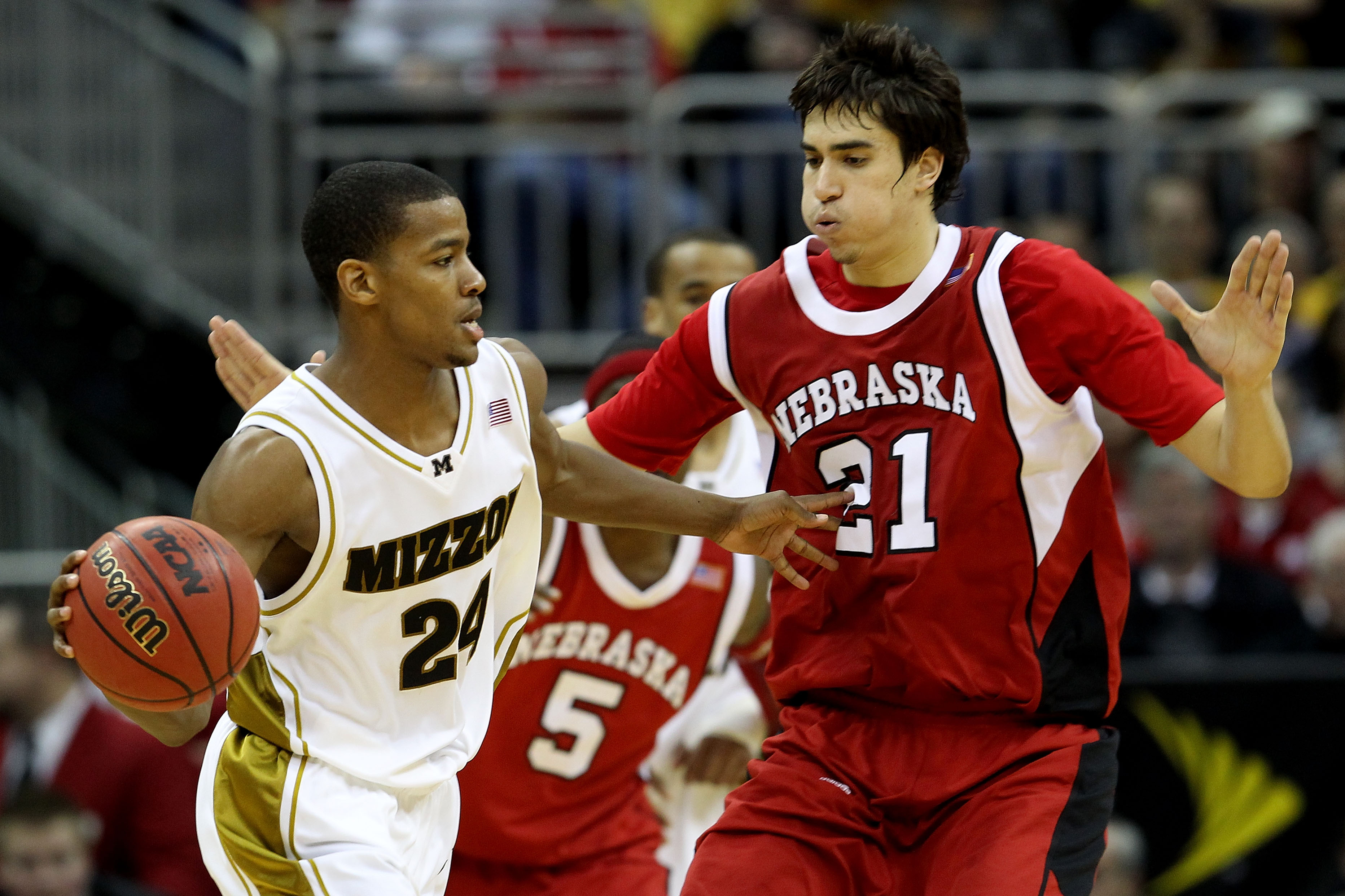 KANSAS CITY, MO - MARCH 10:  Kim English #24 of the Missouri Tigers looks to pass the ball as he is guarded by Jorge Brian Diaz #21 of the Nebraska Cornhuskers in the second half during the first round game of the 2010 Phillips 66 Big 12 Men's Basketball
