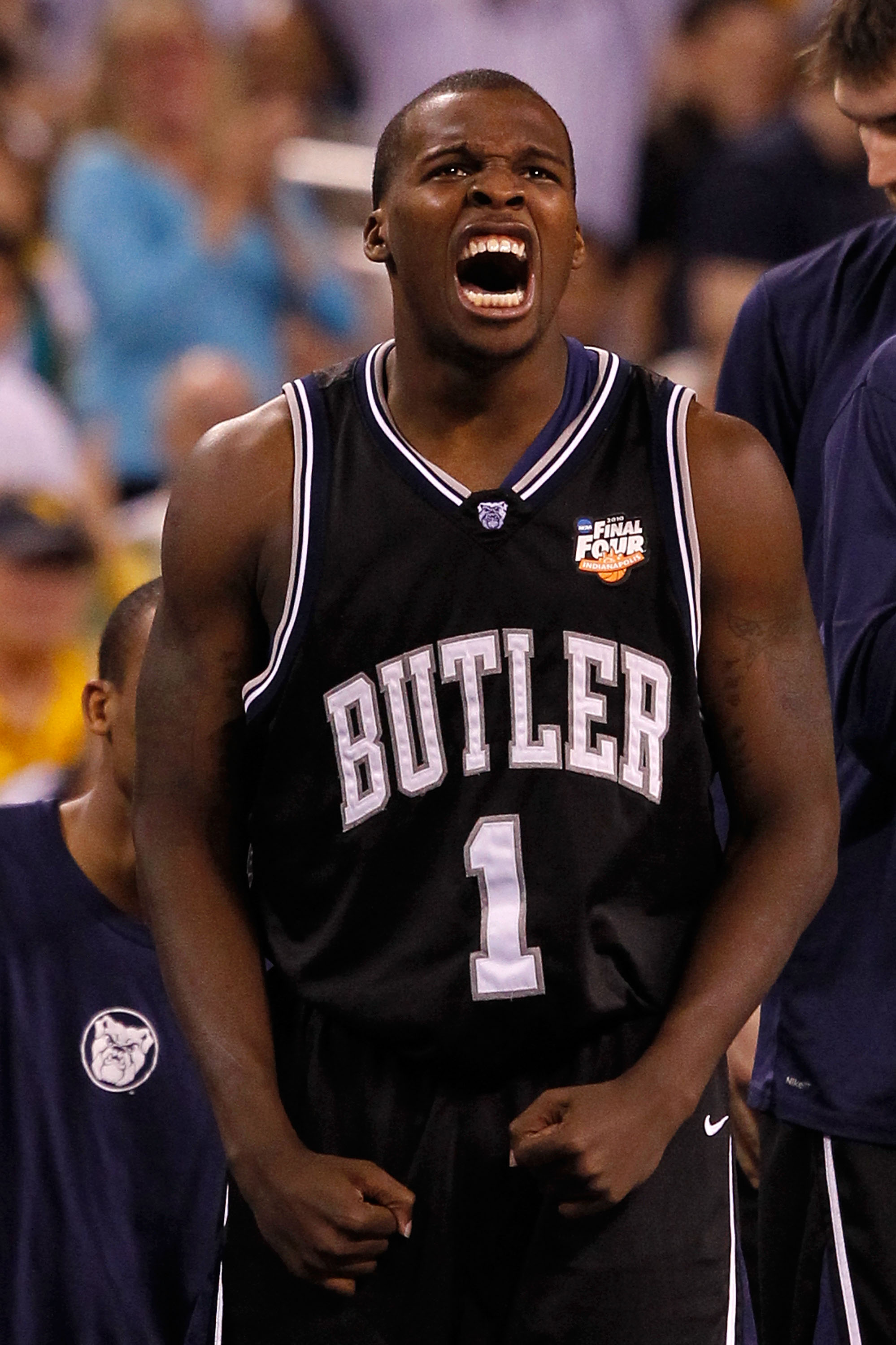 INDIANAPOLIS - APRIL 03:  Shelvin Mack #1 of the Butler Bulldogs celebrates on the bench against the Michigan State Spartans during the National Semifinal game of the 2010 NCAA Division I Men's Basketball Championship on April 3, 2010 in Indianapolis, Ind