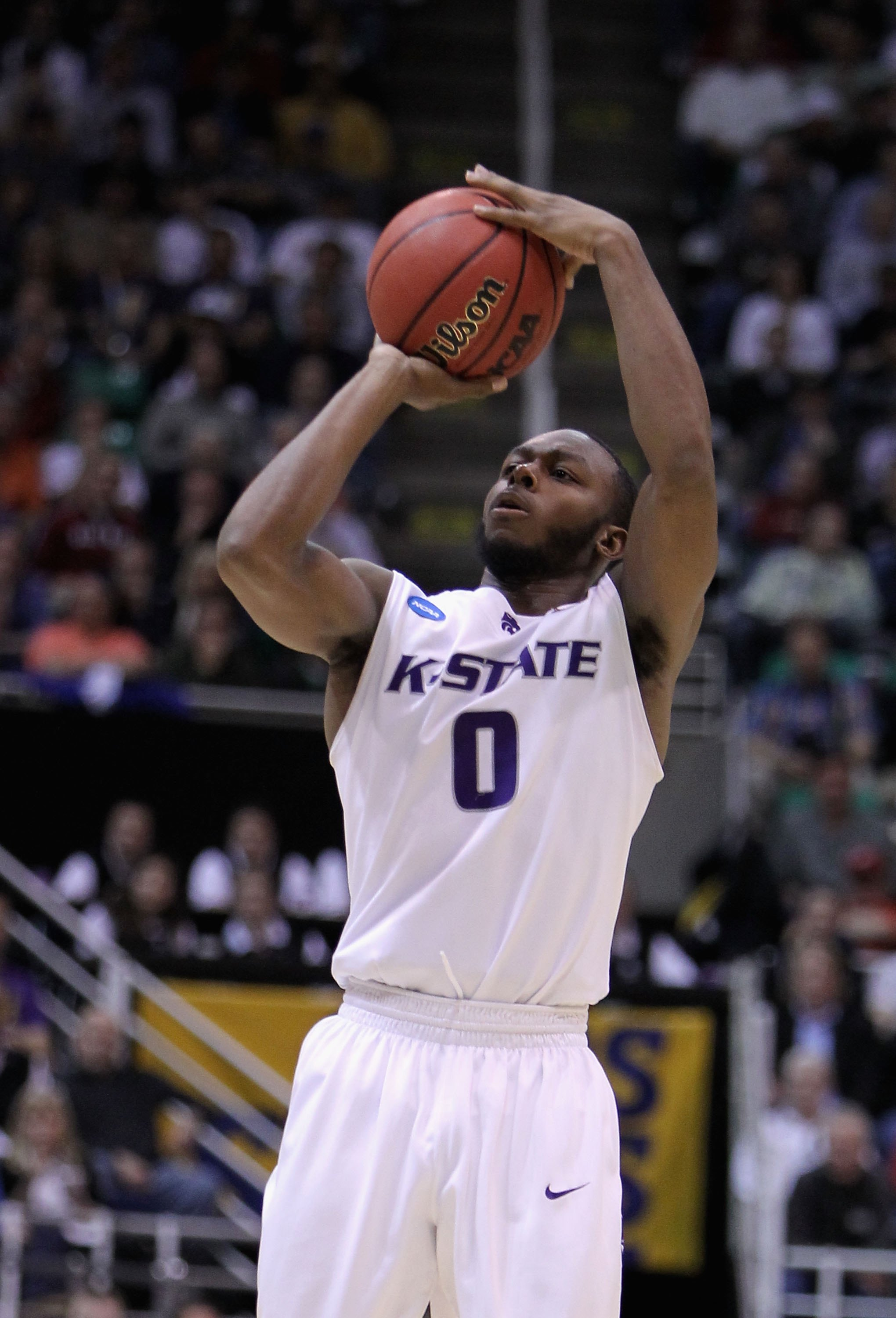 SALT LAKE CITY - MARCH 25:  Jacob Pullen #0 of the Kansas State Wildcats puts up a shot against the Xavier Musketeers during the west regional semifinal of the 2010 NCAA men's basketball tournament at the Energy Solutions Arena on March 25, 2010 in Salt L