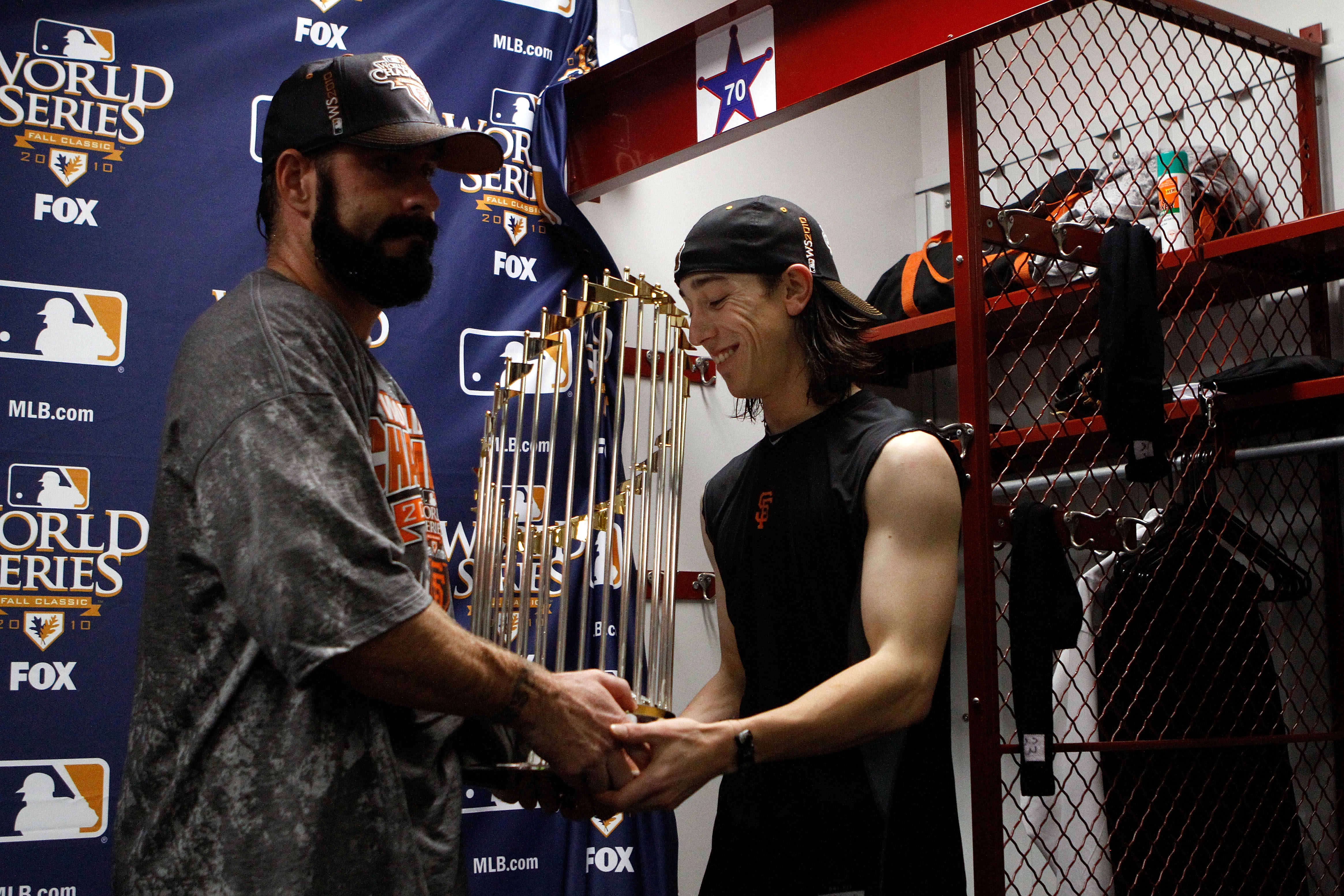 ARLINGTON, TX - NOVEMBER 01:  (L-R) Brian Wilson #28 and Tim Lincecum #55 of the San Francisco Giants celebrate with the World Series trophy in the locker room after the Giants won 3-1 against the Texas Rangers in Game Five of the 2010 MLB World Series at
