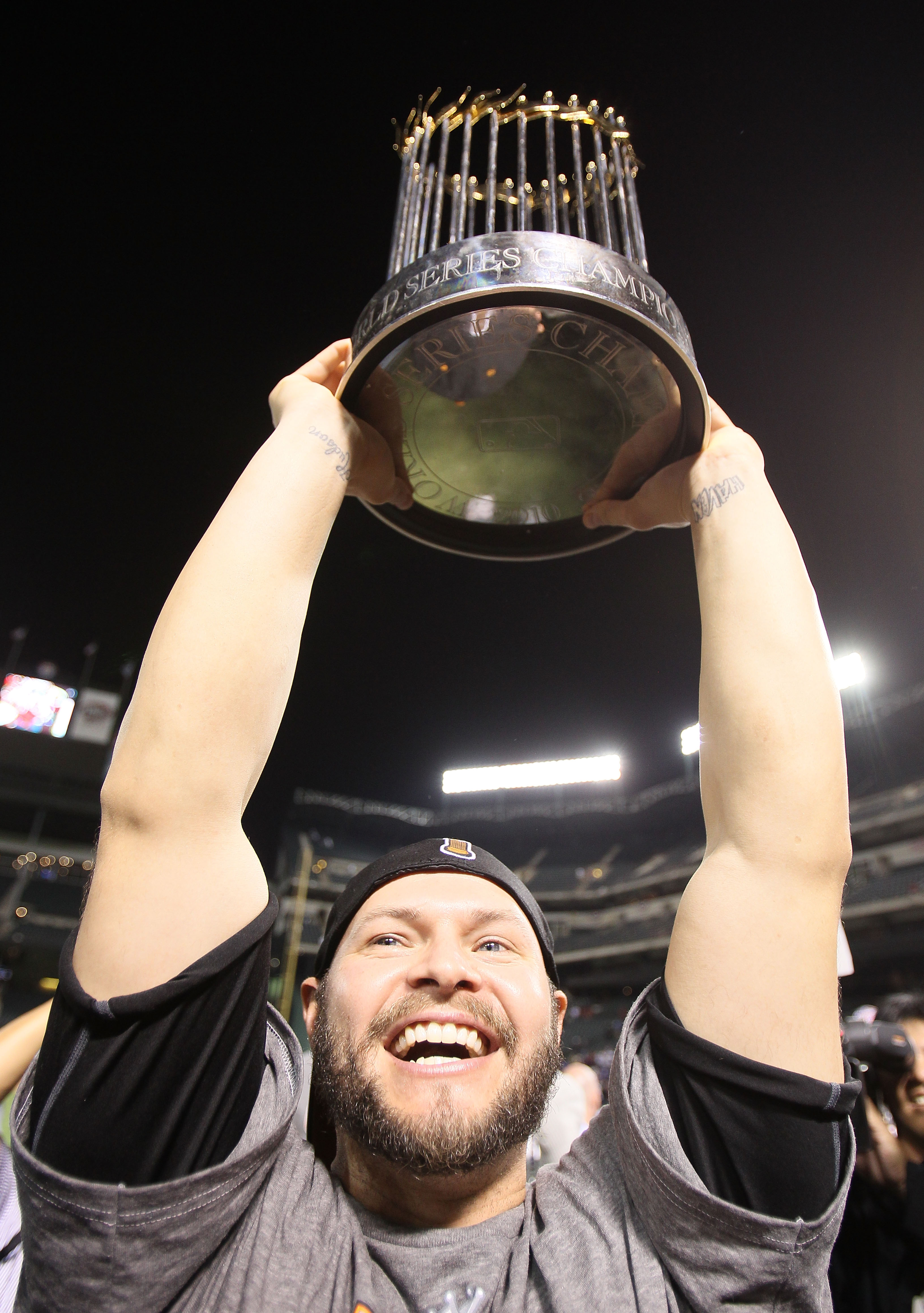 ARLINGTON, TX - NOVEMBER 01:  Cody Ross #13 of the San Francisco Giants celebrates with the World Series Championship trophy after the Giants won 3-1 the Texas Rangers in Game Five of the 2010 MLB World Series at Rangers Ballpark in Arlington on November