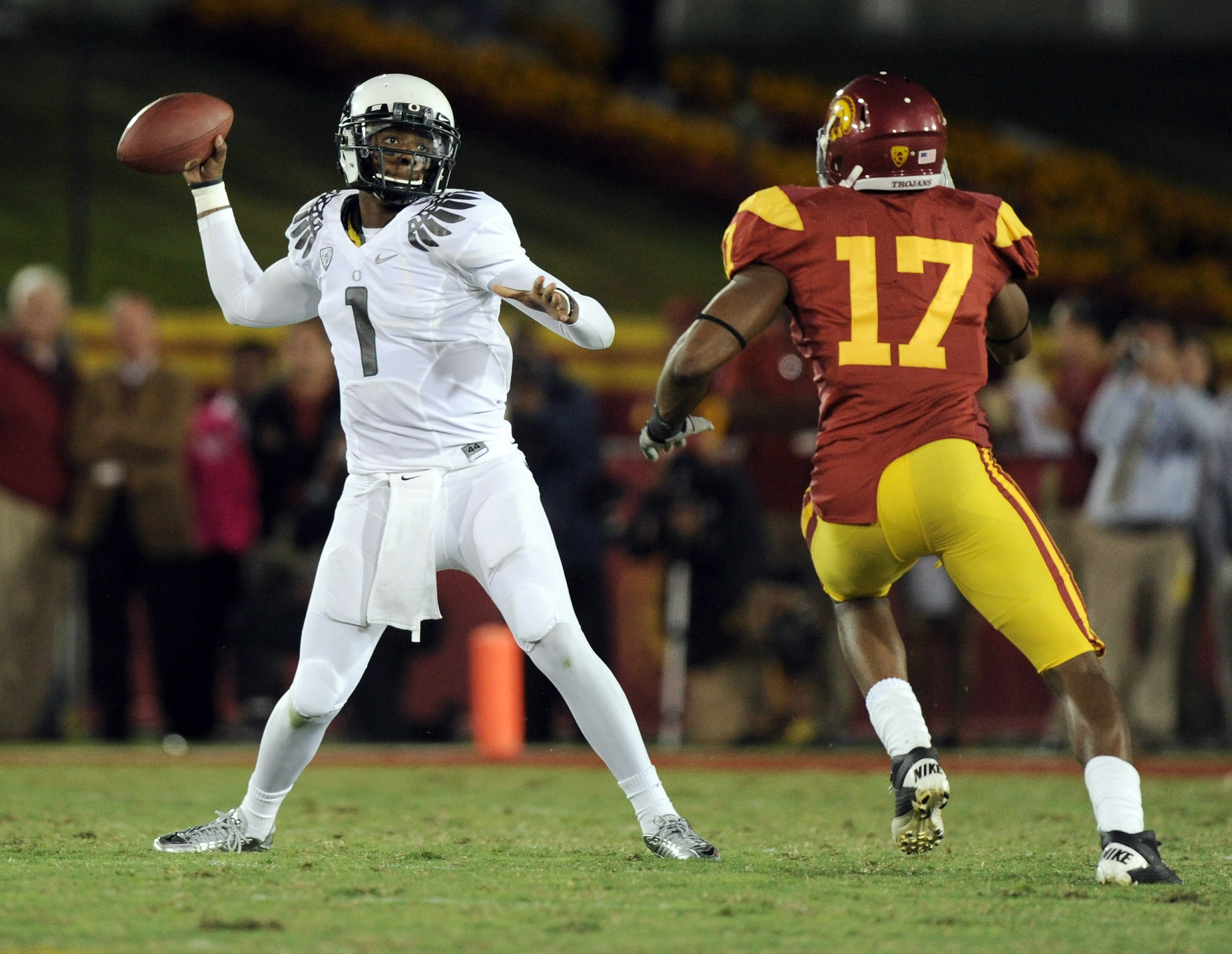 LOS ANGELES, CA - OCTOBER 30:  Darron Thomas #1 of the Oregon Ducks passes in front of Michael Morgan #17 of the USC Trojans during the second quarter at Los Angeles Memorial Coliseum on October 30, 2010 in Los Angeles, California.  (Photo by Harry How/Ge