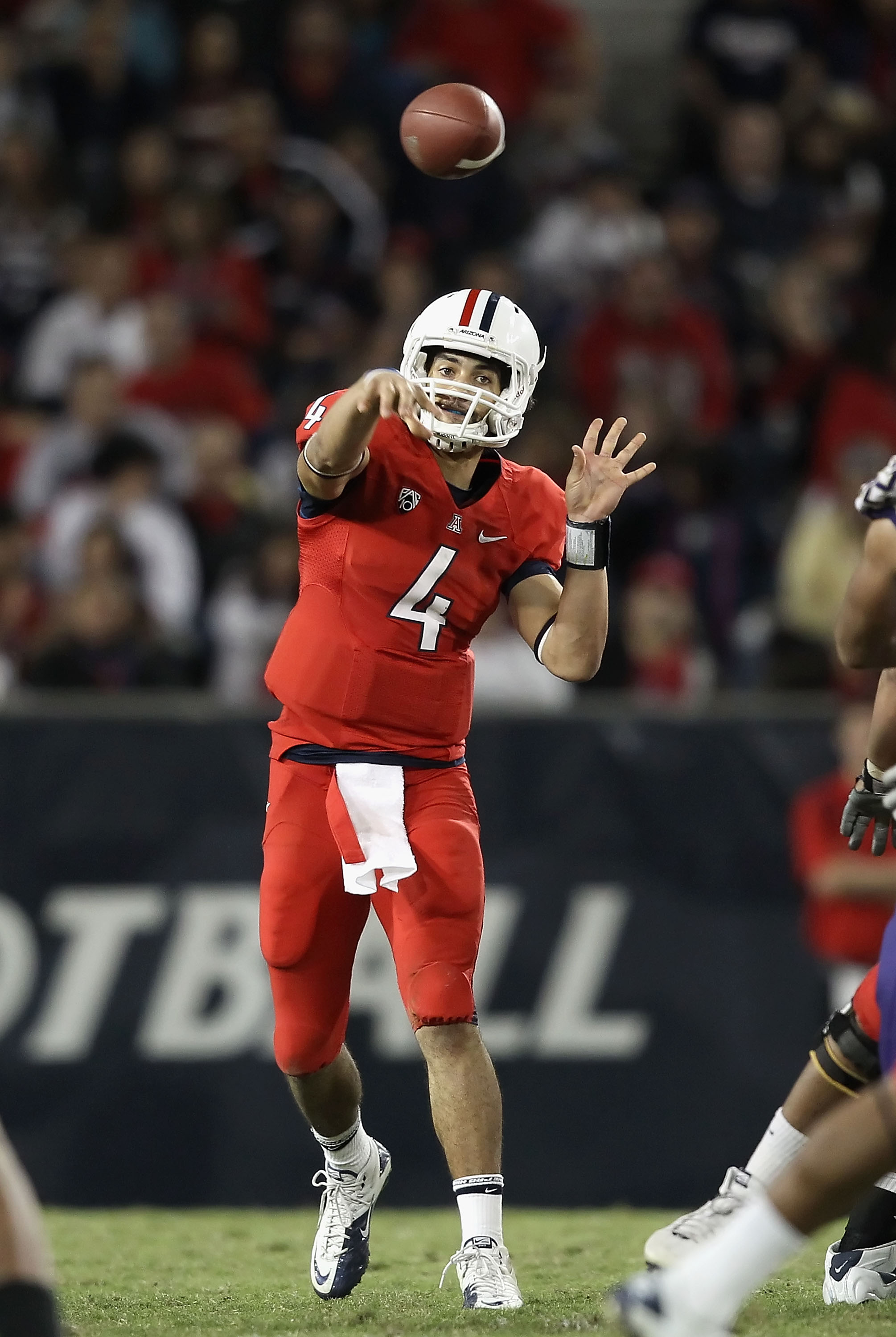 TUCSON, AZ - OCTOBER 23:  Quarterback Matt Scott #4 of the Arizona Wildcats throws a pass during the college football game against the Washington Huskies at Arizona Stadium on October 23, 2010 in Tucson, Arizona.  (Photo by Christian Petersen/Getty Images