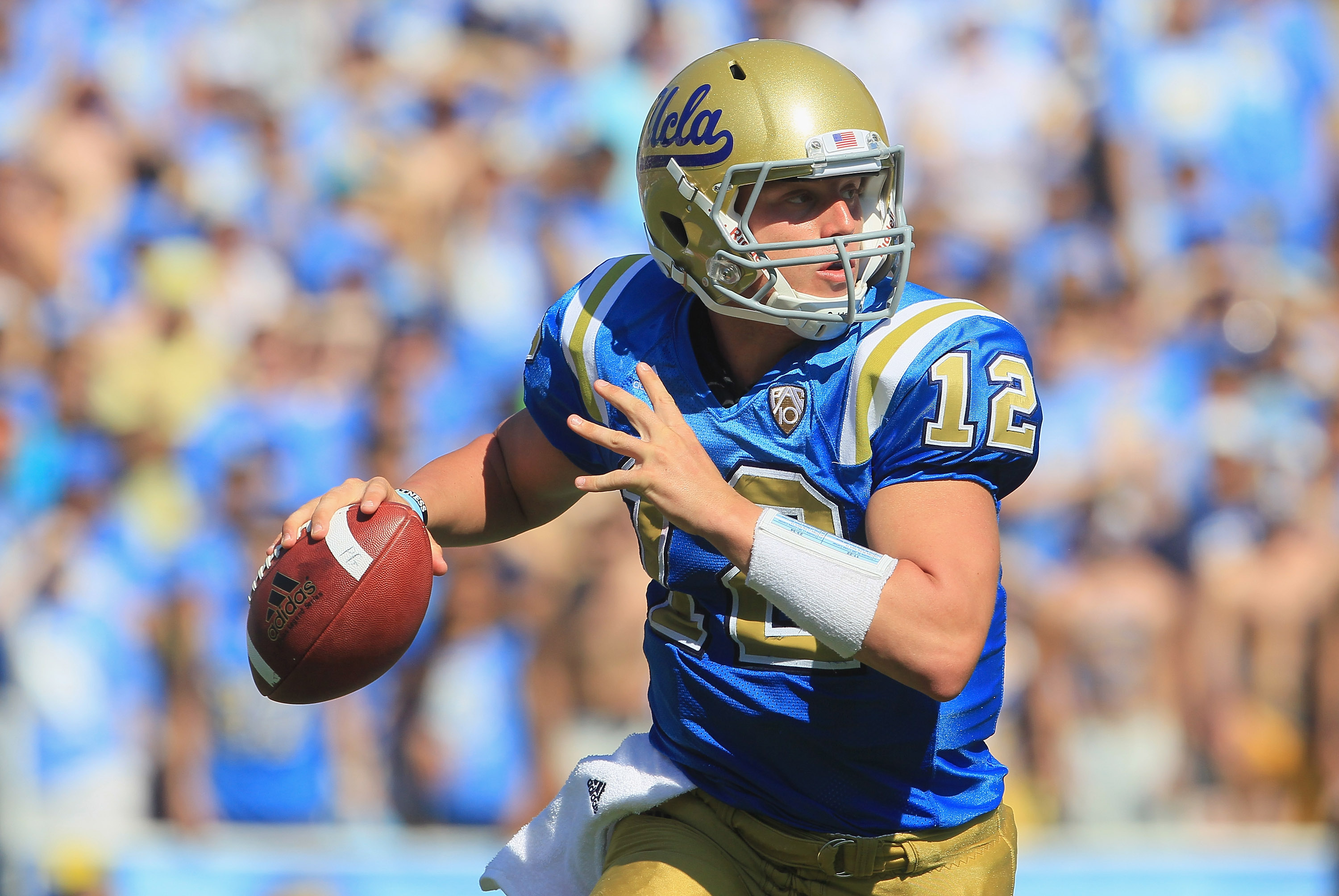 PASADENA, CA - OCTOBER 02:  Quarterback Richard Brehaut #12 of the UCLA Bruins looks down field for an open receiver against the Washington State Cougars during the third quarter at the Rose Bowl on October 2, 2010 in Pasadena, California. UCLA defeated W