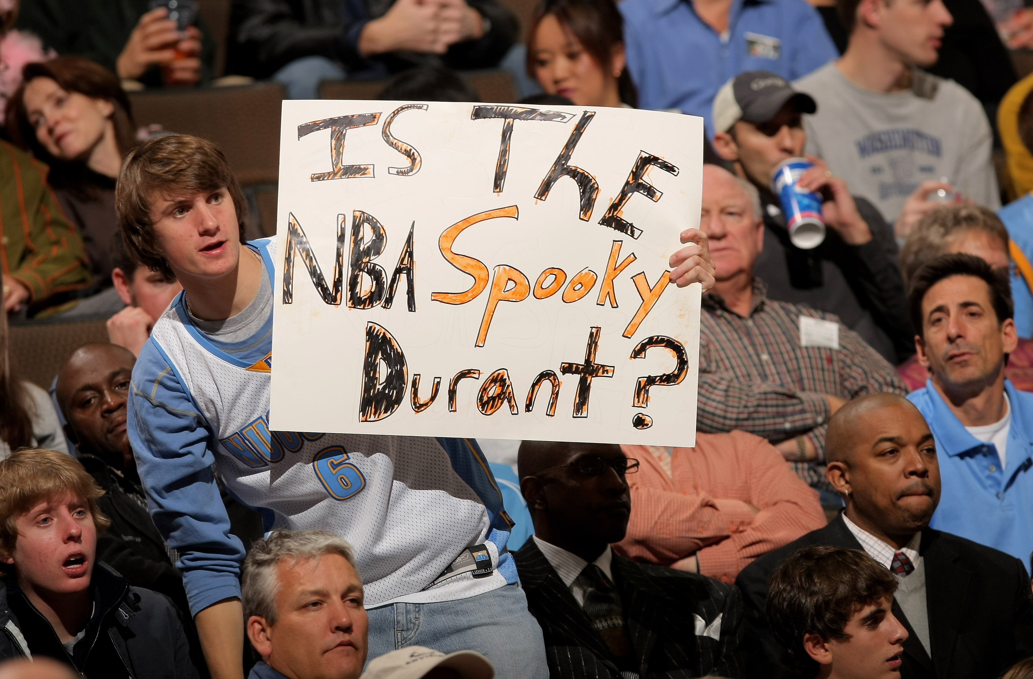DENVER - OCTOBER 31: A fan poses a question to Kevin Durant #35 of the Seattle SuperSonics as he makes his NBA debut against the Denver Nuggets on Halloween at the Pepsi Center on October 31, 2007 in Denver, Colorado. NOTE TO USER: User expressly acknowle