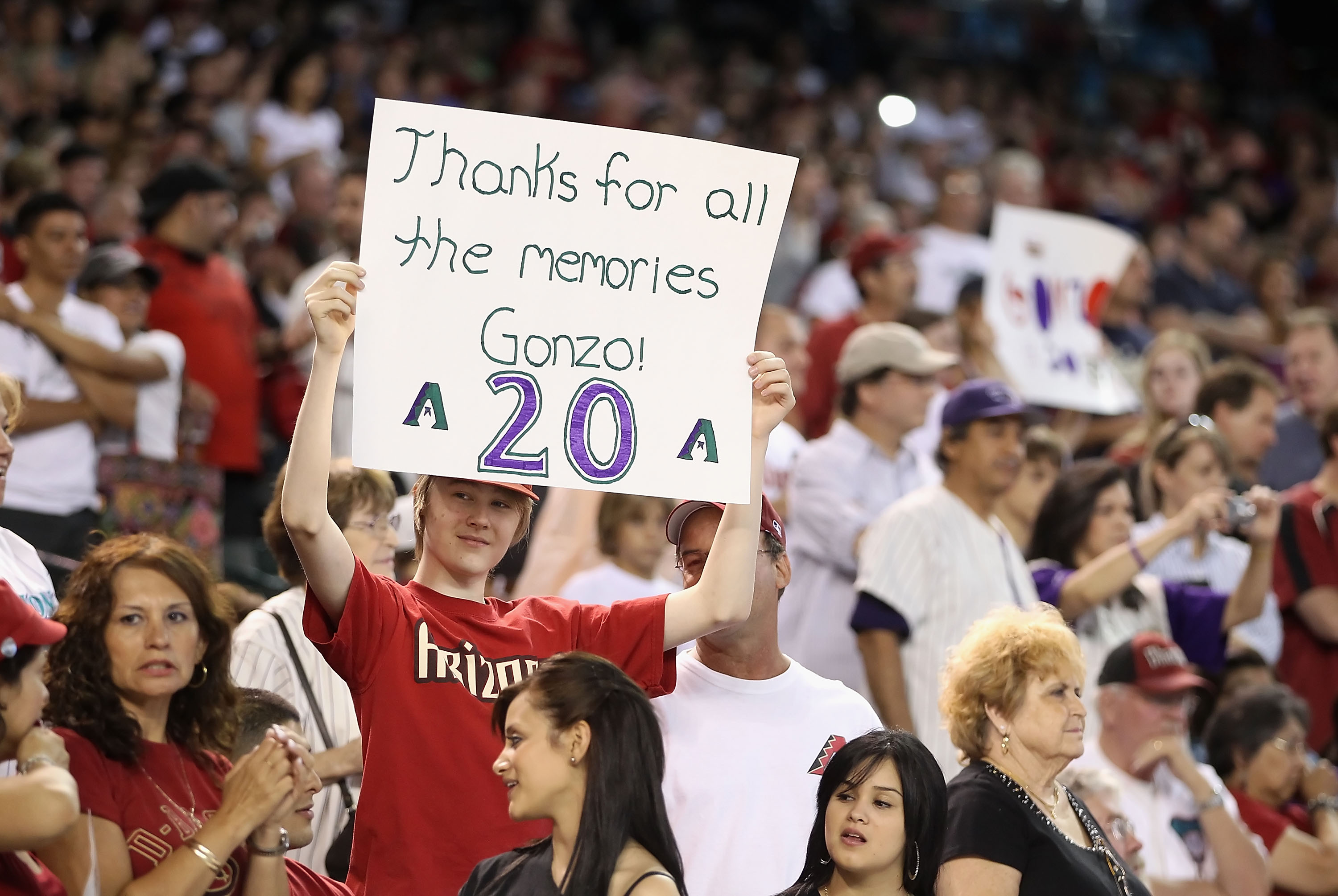 0d044358189 PHOENIX - AUGUST 07  Fans hold signs in honor of Luis Gonzalez getting his  number