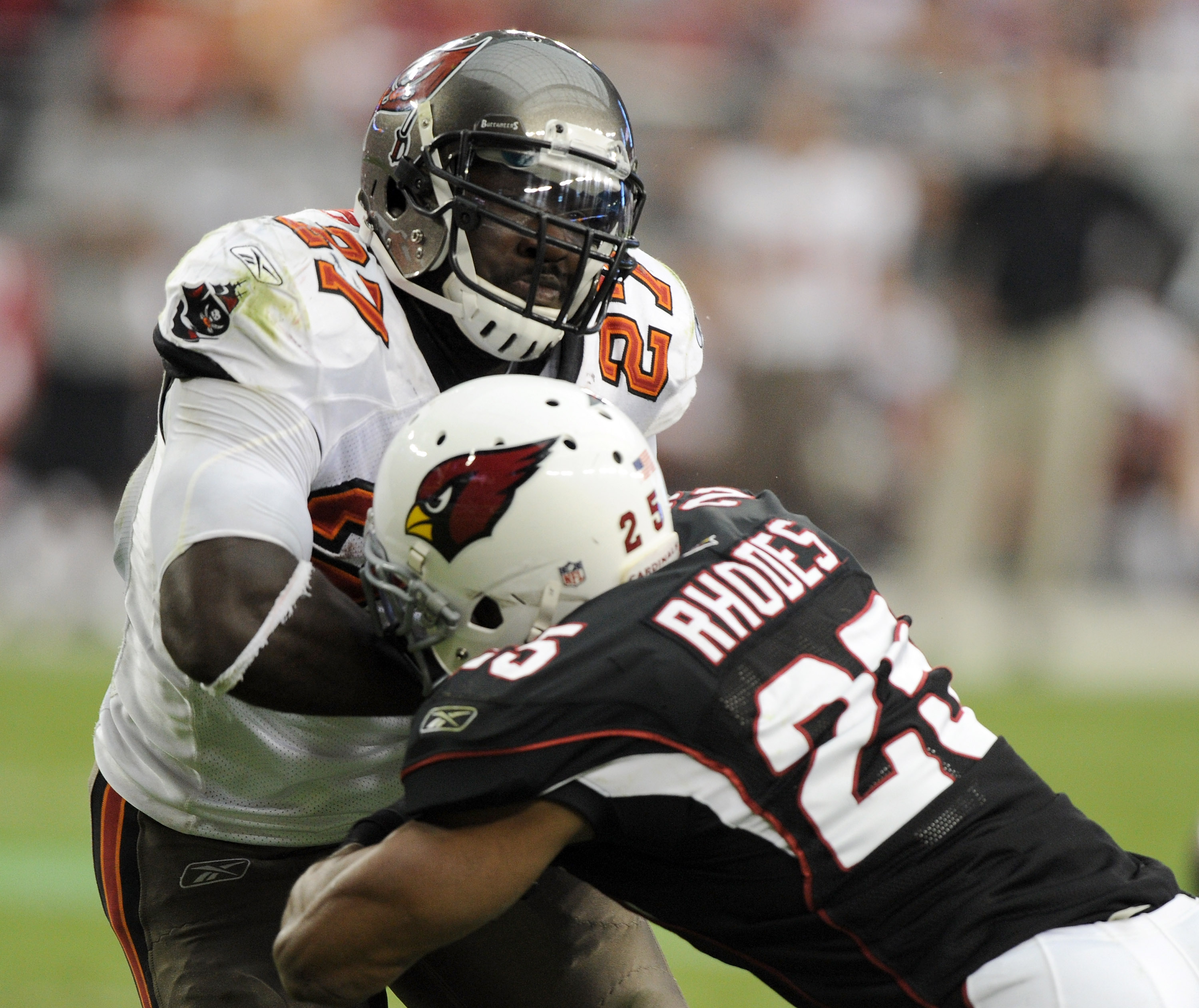 GLENDALE, AZ - OCTOBER 31:  LeGarrette Blount #27 of the Tampa Bay Buccaneers bounces off the tackle of Kerry Rhodes #25 of the Arizona Cardinals for a 31-14 lead during the third quarter at University of Phoenix Stadium on October 31, 2010 in Glendale, A