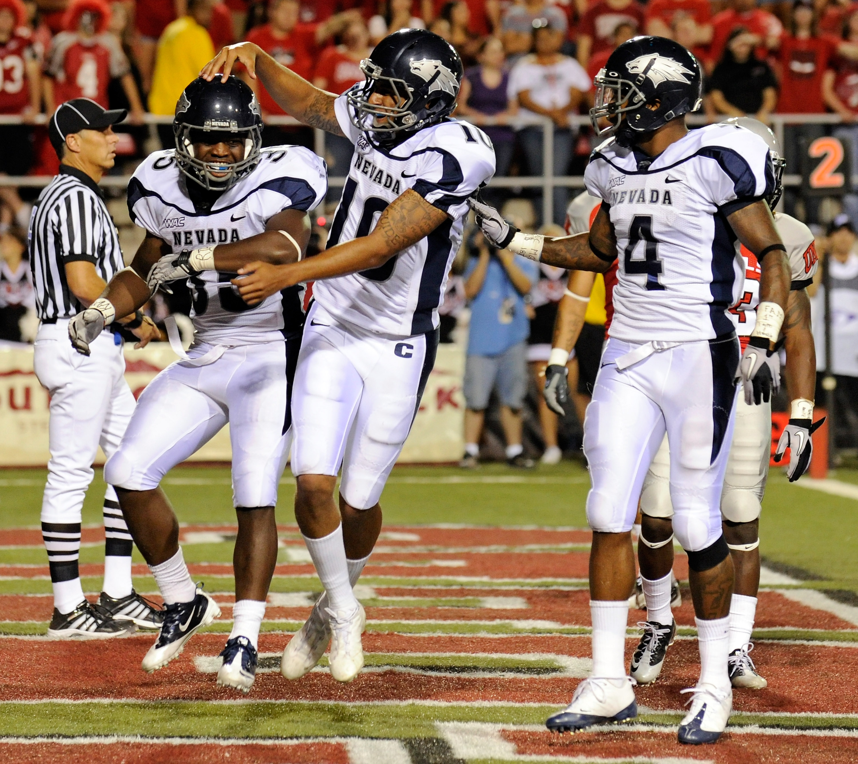 LAS VEGAS - OCTOBER 02:  (L-R) Courtney Randall #35 of the Nevada Reno Wolf Pack is congratulated by quarterback Colin Kaepernick #10 and Brandon Wimberly #4 after Randall scored a touchdown against the UNLV Rebels in the second quarter of their game at S