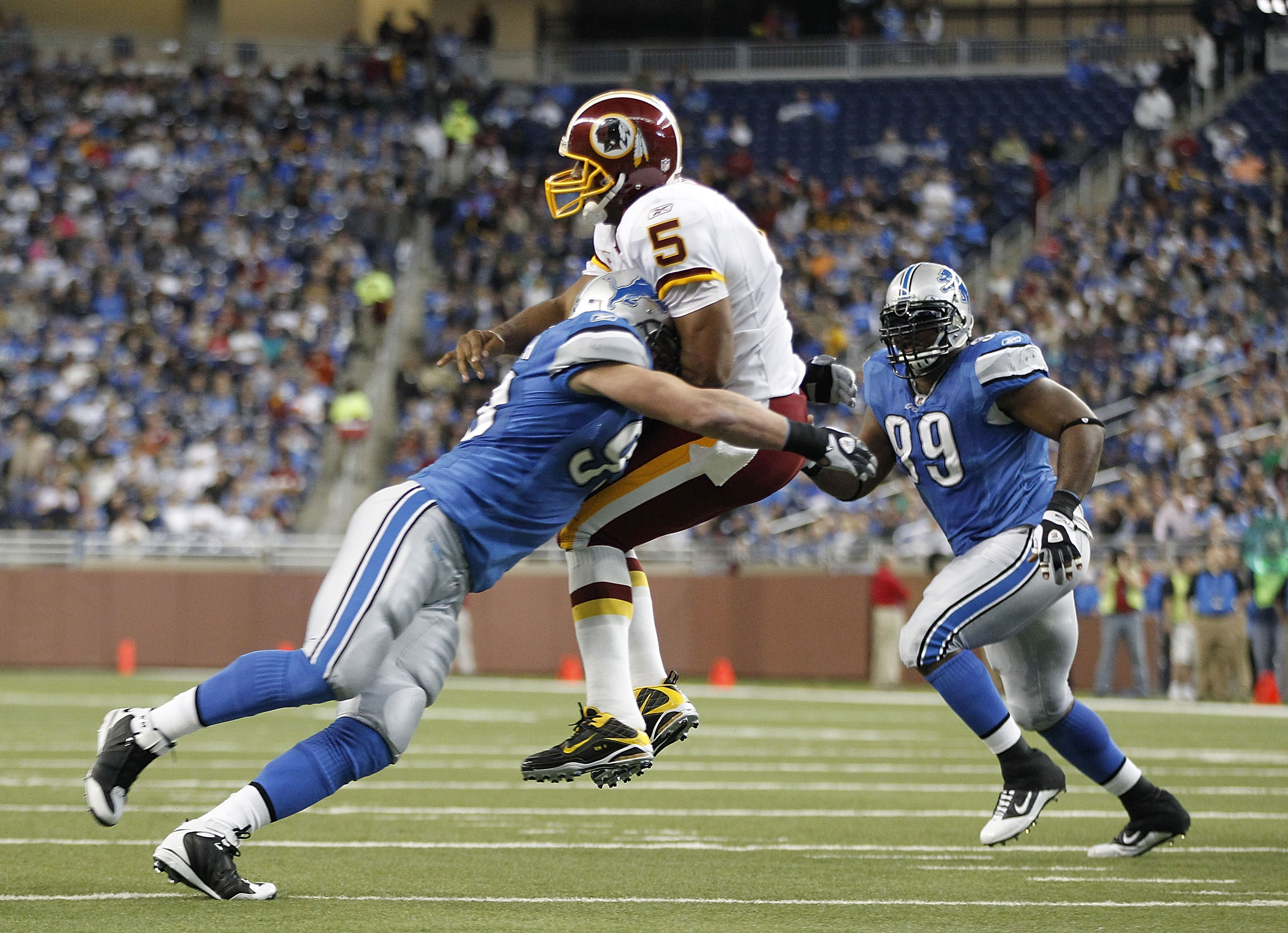 DETROIT - OCTOBER 31: Kyle Vanden Bosch #93 of the Detroit Lions hits Donovan McNabb #5 of the Washington Redskins during the first quarter of the game at Ford Field on October 31, 2010 in Detroit, Michigan. (Photo by Leon Halip/Getty Images)