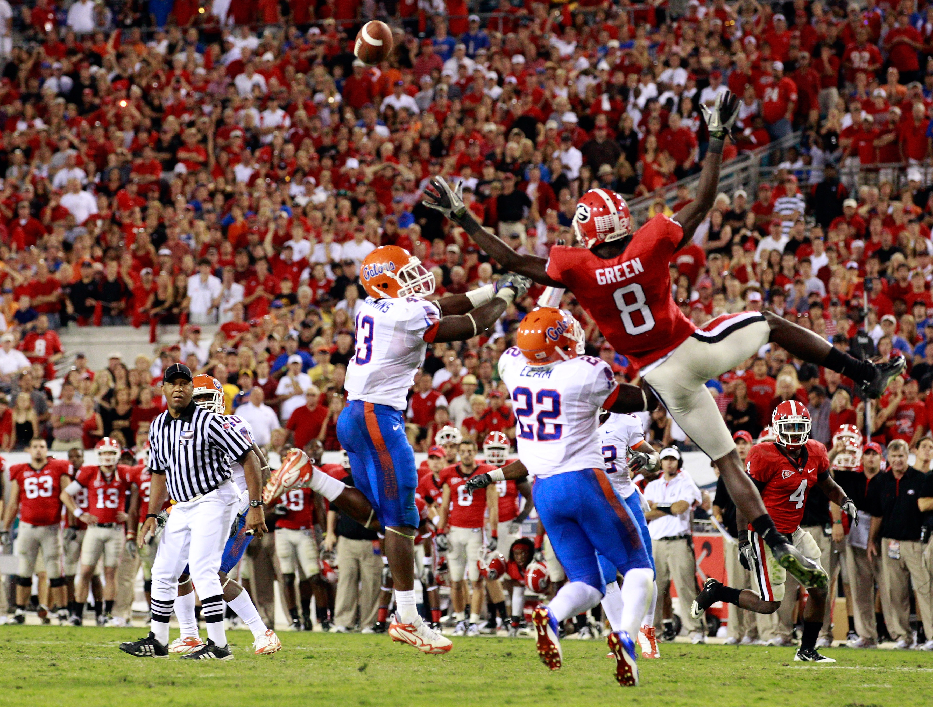 JACKSONVILLE, FL - OCTOBER 30:  A.J. Green #8 of the Georgia Bulldogs attempts to catch a pass against Jelani Jenkins #43 and Matt Elam #22 of the Florida Gators during the game at EverBank Field on October 30, 2010 in Jacksonville, Florida.  (Photo by Sa