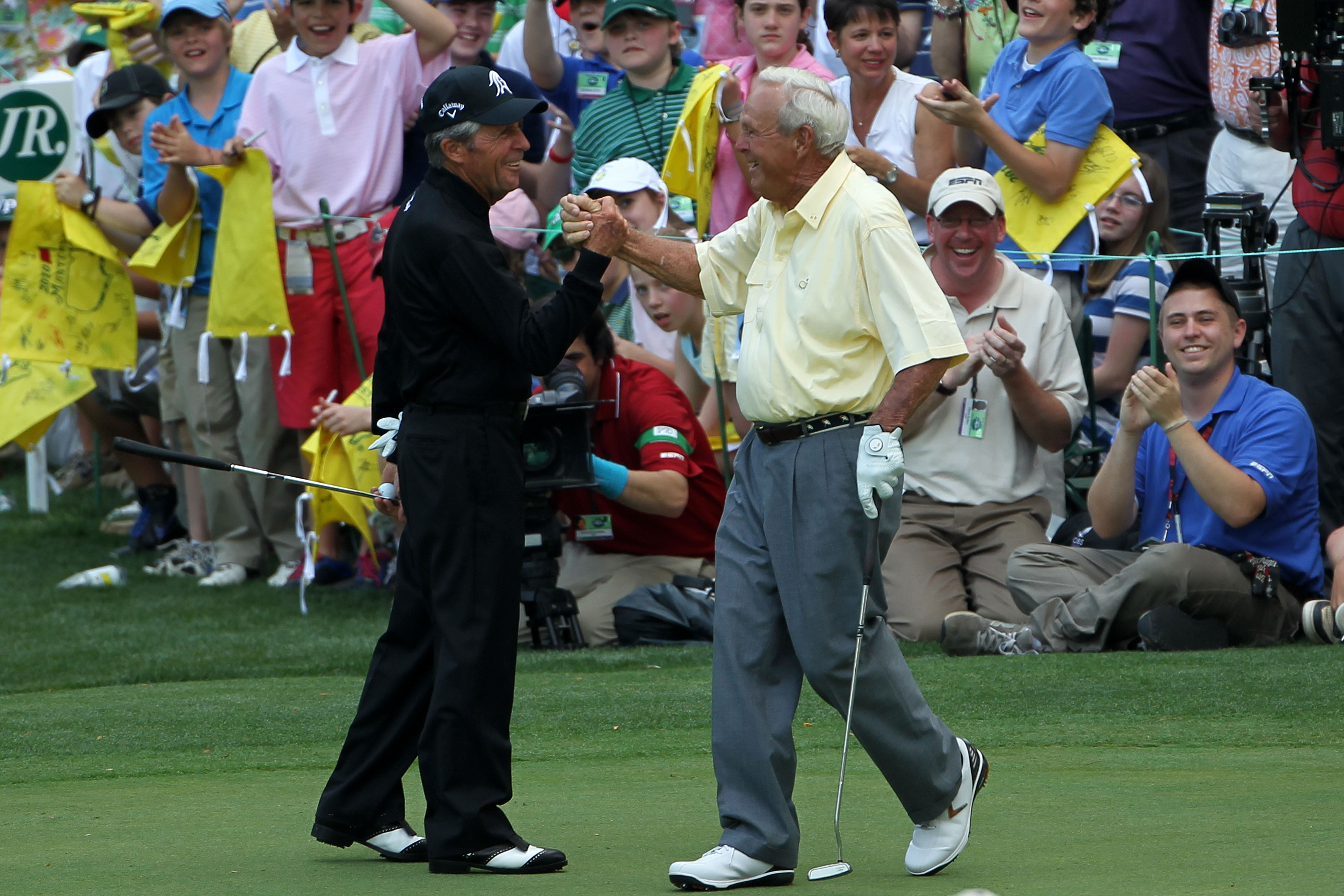 AUGUSTA, GA - APRIL 07:  Gary Player (L) congratulates Arnold Palmer on sinking a long birdie putt during the Par 3 Contest prior to the 2010 Masters Tournament at Augusta National Golf Club on April 7, 2010 in Augusta, Georgia.  (Photo by Jamie Squire/Ge