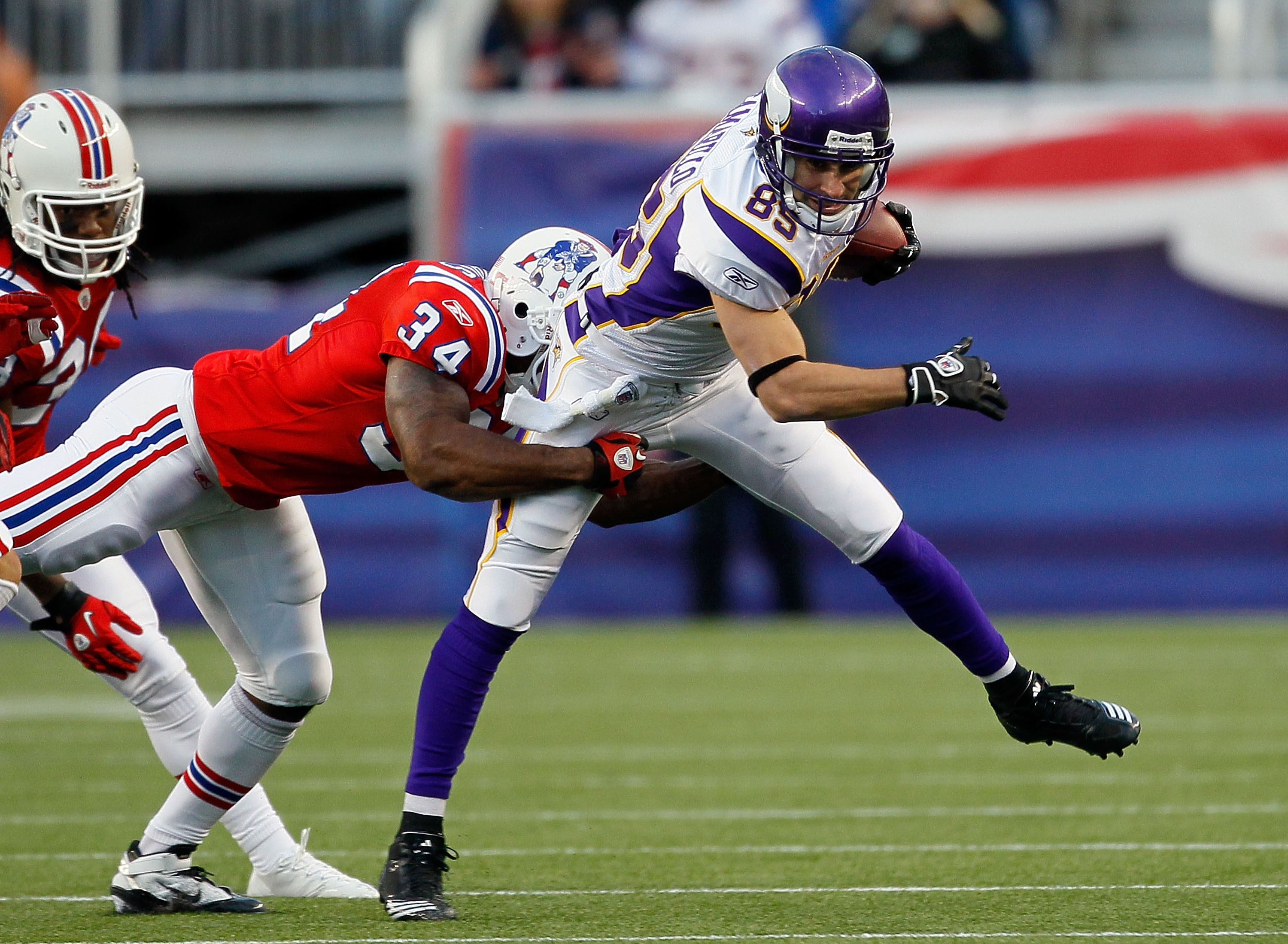FOXBORO, MA - OCTOBER 31:  Greg Camarillo #85 of the Minnesota Vikings is stopped by Sammy Morris #34 of the New England Patriots at Gillette Stadium on October 31, 2010 in Foxboro, Massachusetts. (Photo by Jim Rogash/Getty Images)