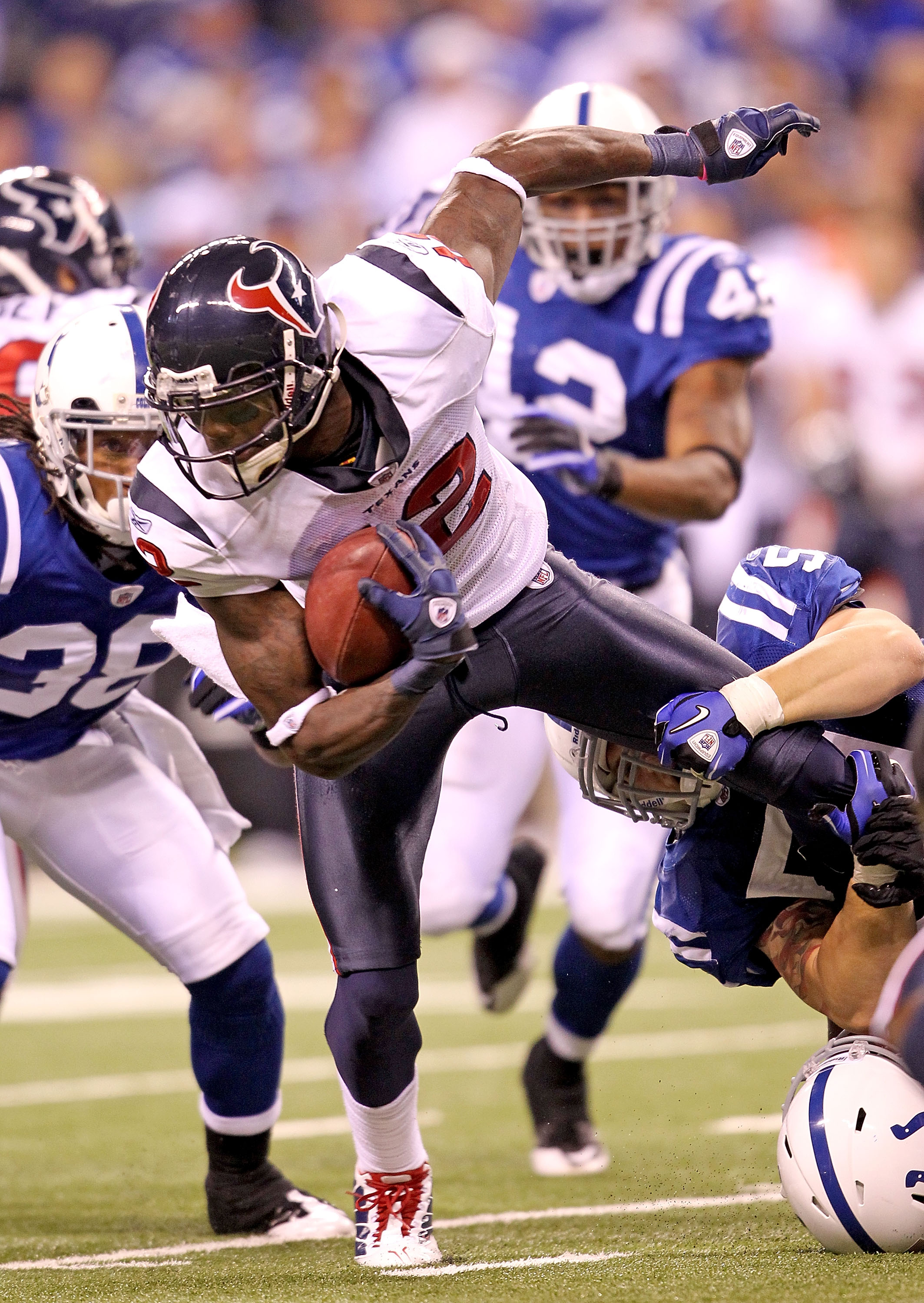INDIANAPOLIS - NOVEMBER 01:  Jacoby Jones #12 of Houston Texans is tackled during the NFL game against the Indianapolis Colts at Lucas Oil Stadium on November 1, 2010 in Indianapolis, Indiana.  (Photo by Andy Lyons/Getty Images)