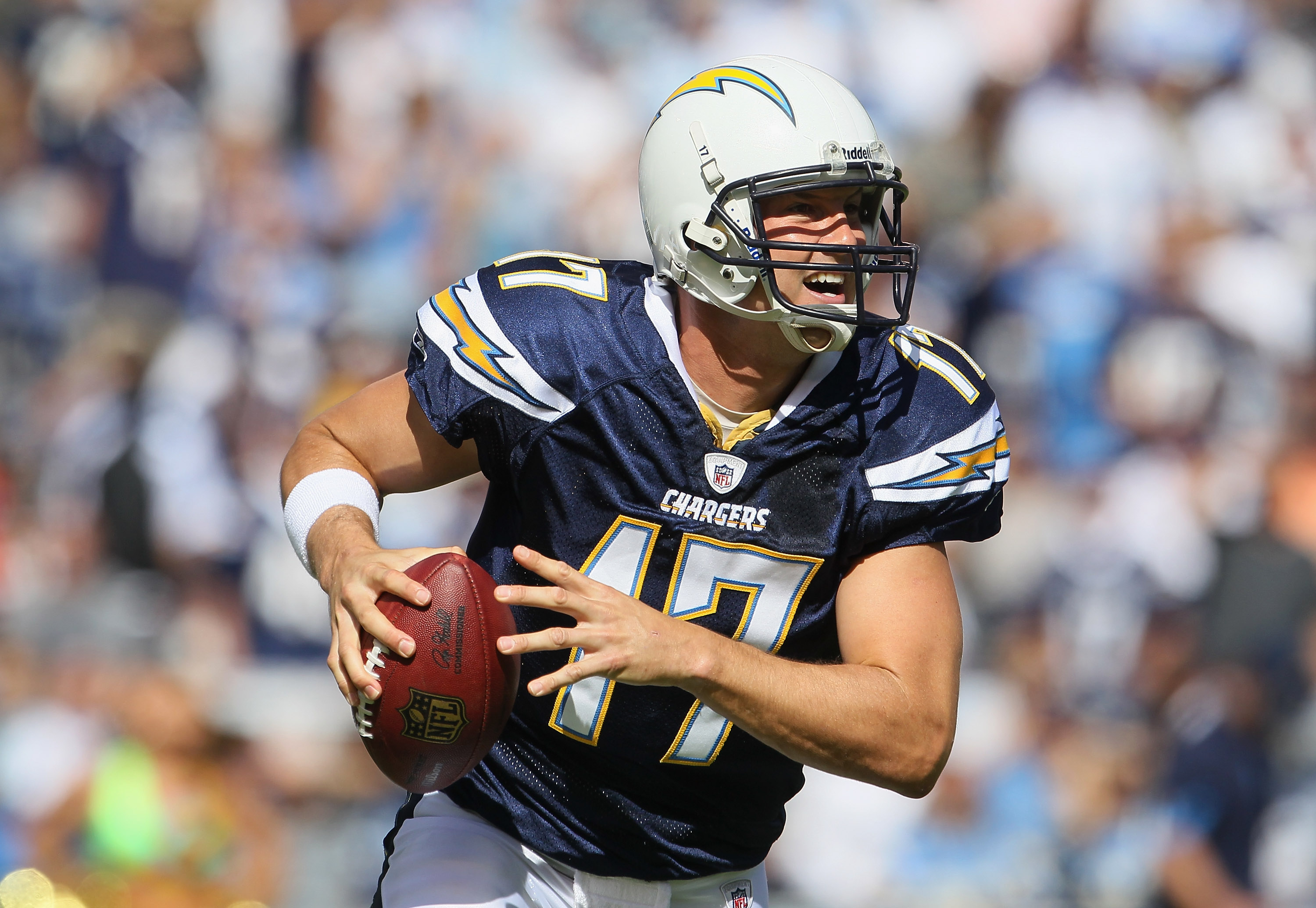 SAN DIEGO - OCTOBER 31:  Quarterback Philip Rivers #17 of the San Diego Chargers looks down field for an open receiver against the Tennessee Titans in the first quarter at Qualcomm Stadium on October 31, 2010 in San Diego, California. The Chargers defeate