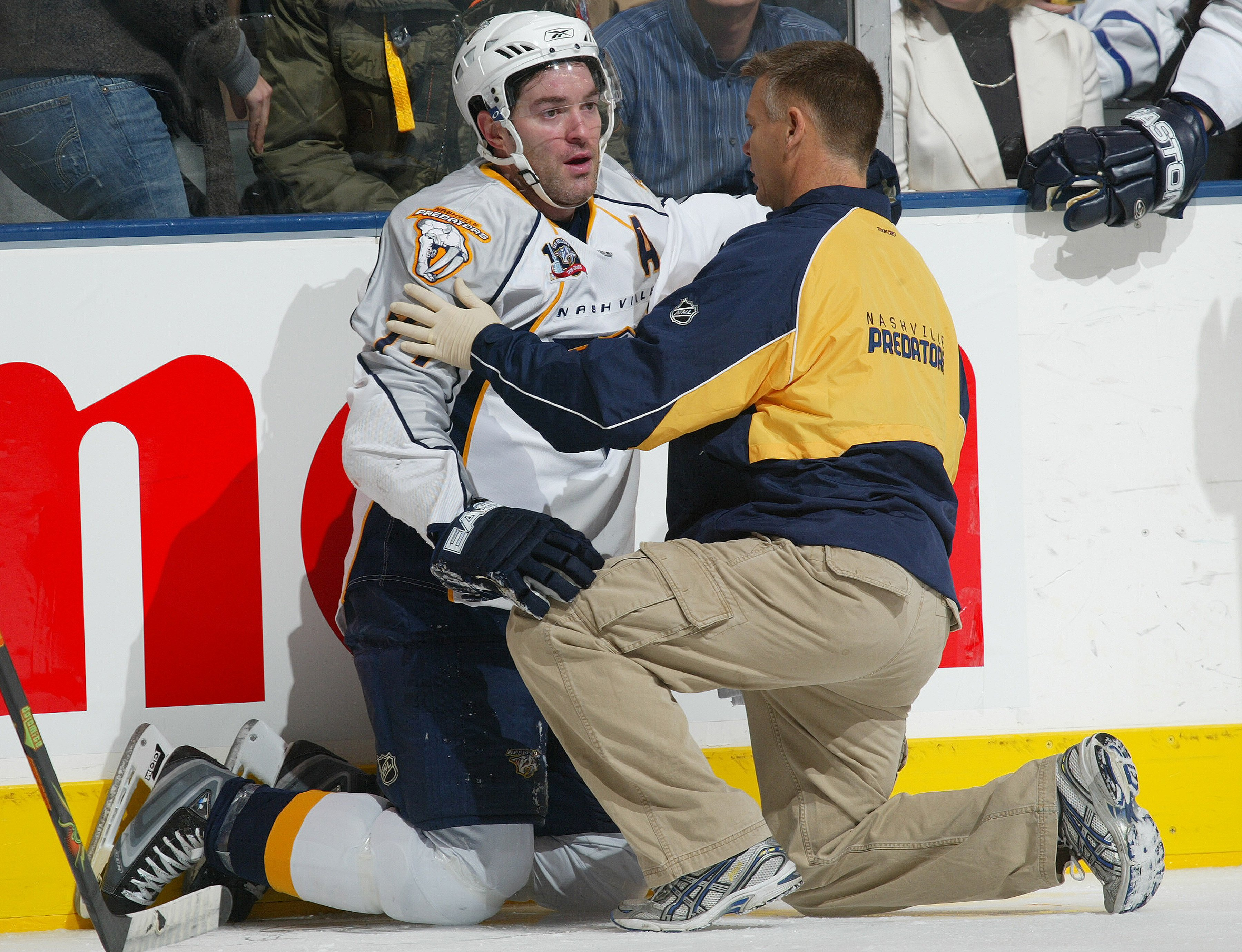 TORONTO - DECEMBER 4:  J.P. Dumont #71 of the Nashville Predators appears stunned after taking a big hit from Hal Gill #25 of the Toronto Maple Leafs in a game on December 4, 2007 at the Air Canada Centre in Toronto, Ontario. The Maple Leafs defeated the