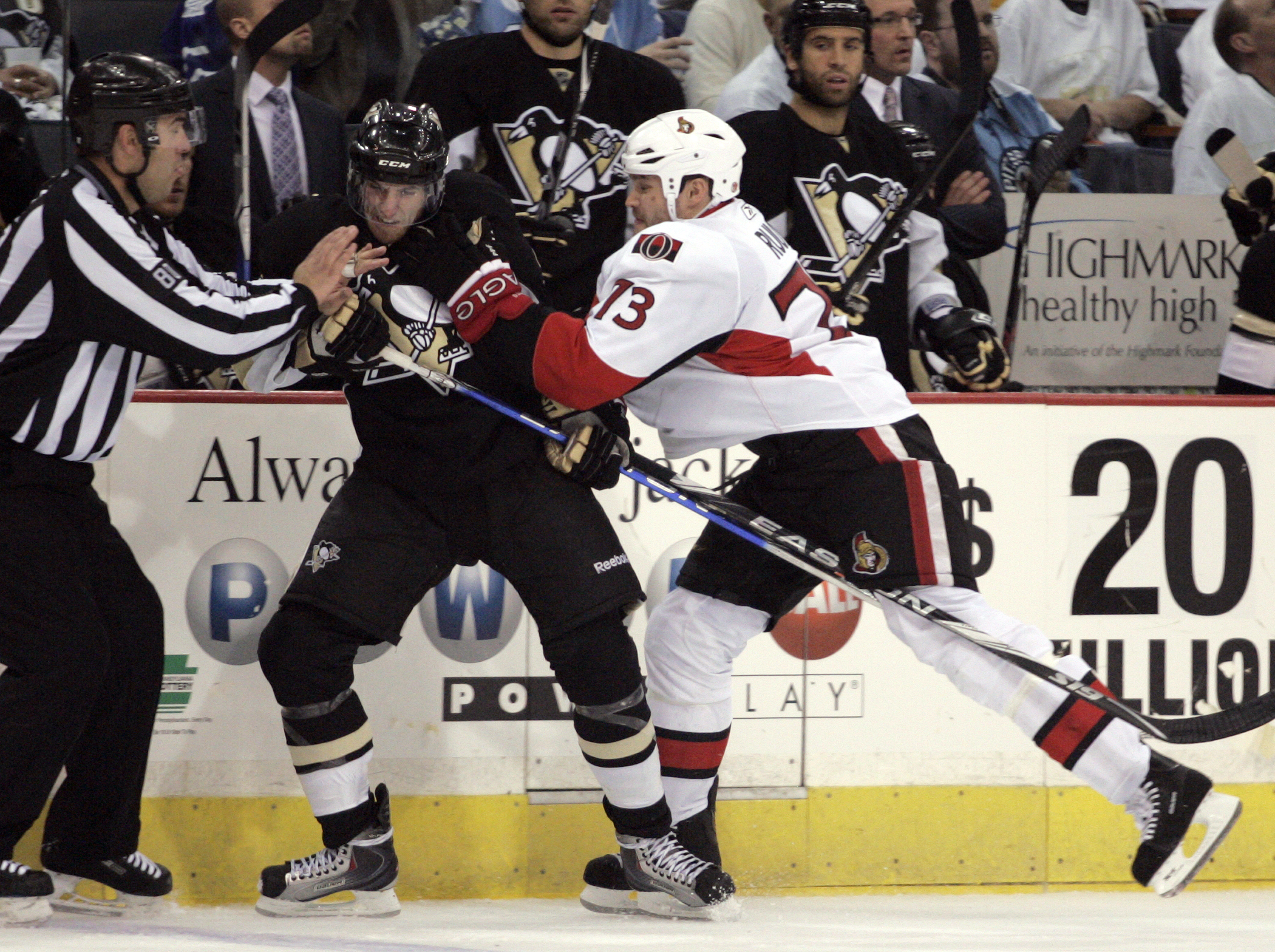 PITTSBURGH - APRIL 22:  Jarkko Ruutu #73 of the Ottawa Senators hits Alex Goligoski #3 of the Pittsburgh Penguins in Game Five of the Eastern Conference Quarterfinals during the 2010 NHL Stanley Cup Playoffs at Mellon Arena on April 22, 2010 in Pittsburgh