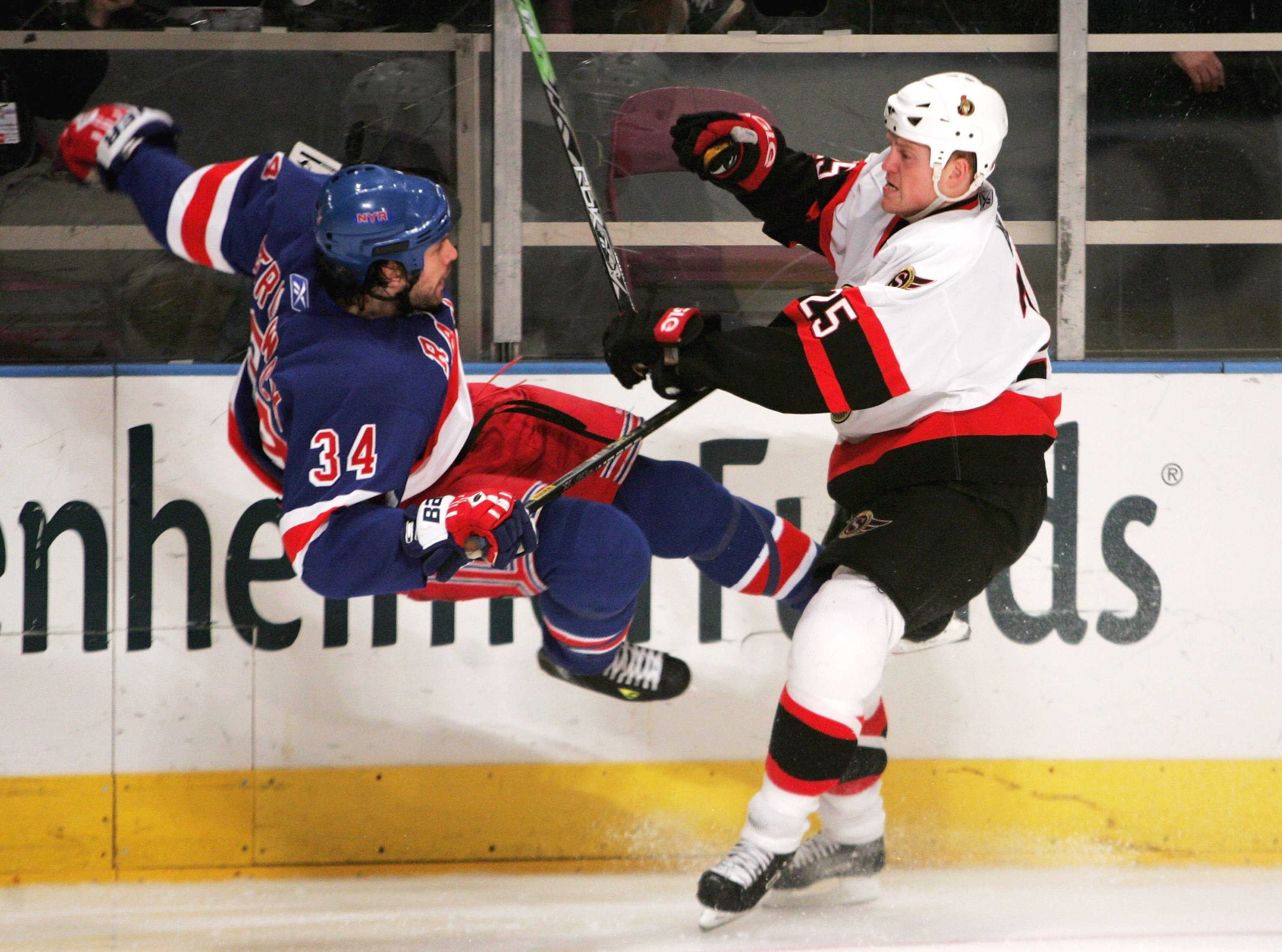 NEW YORK - APRIL 18:  Chris Neil #25 of the Ottawa Senators hits Jason Strudwick #34 of the New York Rangers on April 18, 2006 at Madison Square Garden in New York City. The Senators defeated the Rangers 5-1.  (Photo by Ezra Shaw/Getty Images)