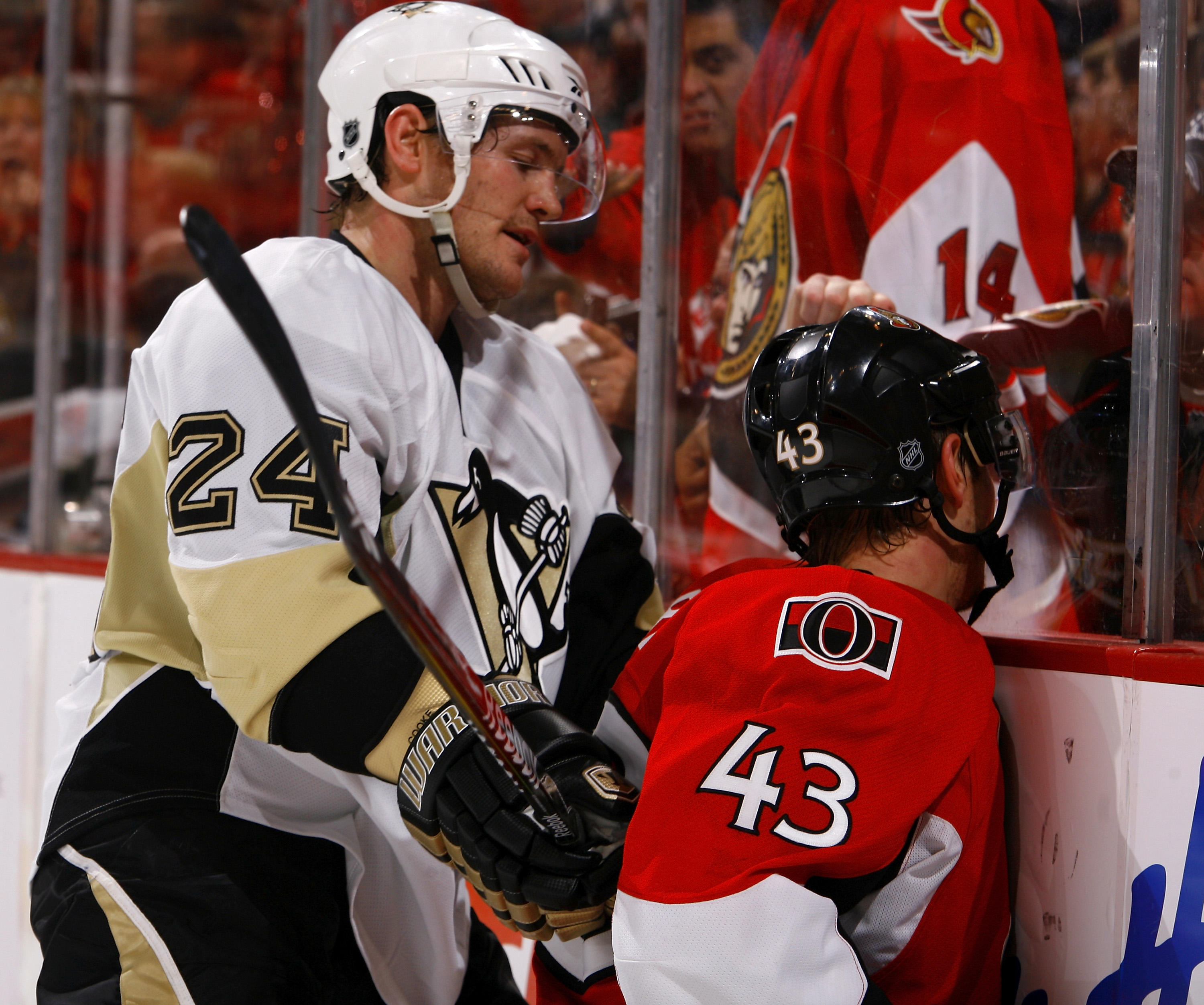 OTTAWA, ON - APRIL 18:  Matt Cooke #24 of the Pittsburgh Penguins reacts after hitting Peter Regin #43 of the Ottawa Senators face first into the boards for a boarding penalty during Game 3 of the Eastern Conference Quaterfinals during the 2010 Stanley Cu