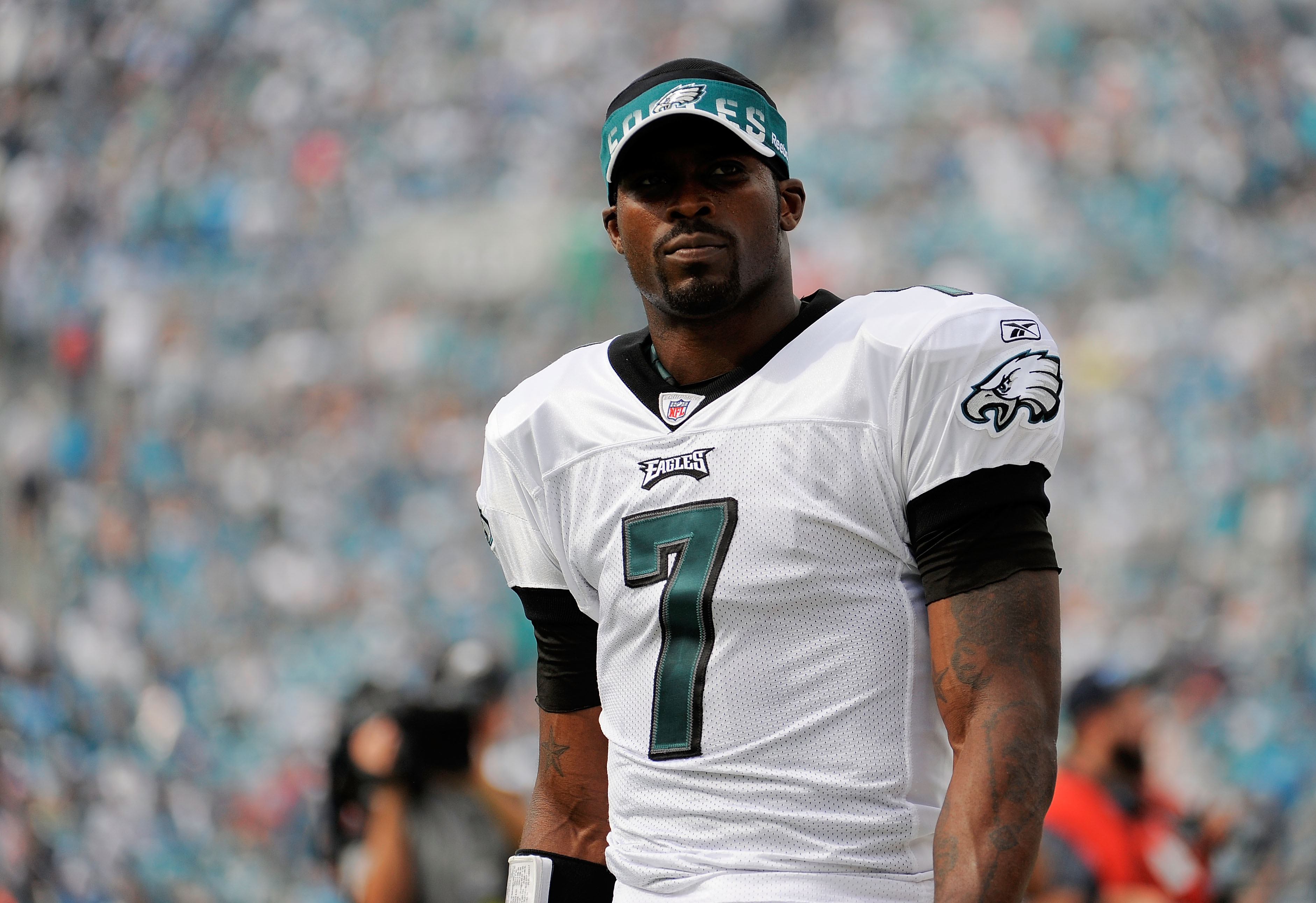 JACKSONVILLE, FL - SEPTEMBER 26:  Quarterback Michael Vick #7 of the Philadelphia Eagles looks toward fans chanting his name before taking on the Jacksonville Jaguars at EverBank Field on September 26, 2010 in Jacksonville, Florida.  (Photo by Doug Benc/G