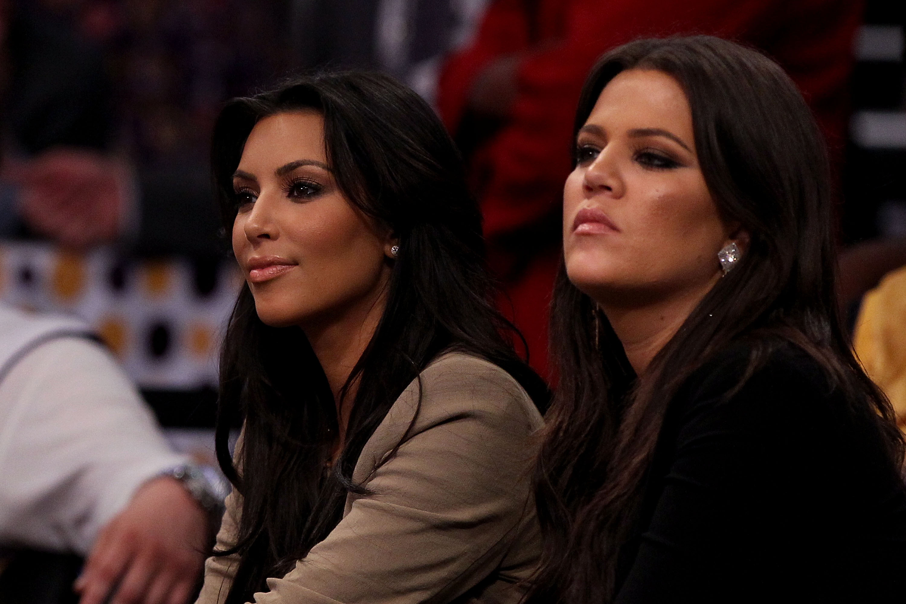LOS ANGELES, CA - JUNE 17:  (L-R) Kim and Khloe Kardashian sit courtside at Game Seven of the 2010 NBA Finals at Staples Center between the Boston Celtics and the Los Angeles Lakers on June 17, 2010 in Los Angeles, California.  NOTE TO USER: User expressl