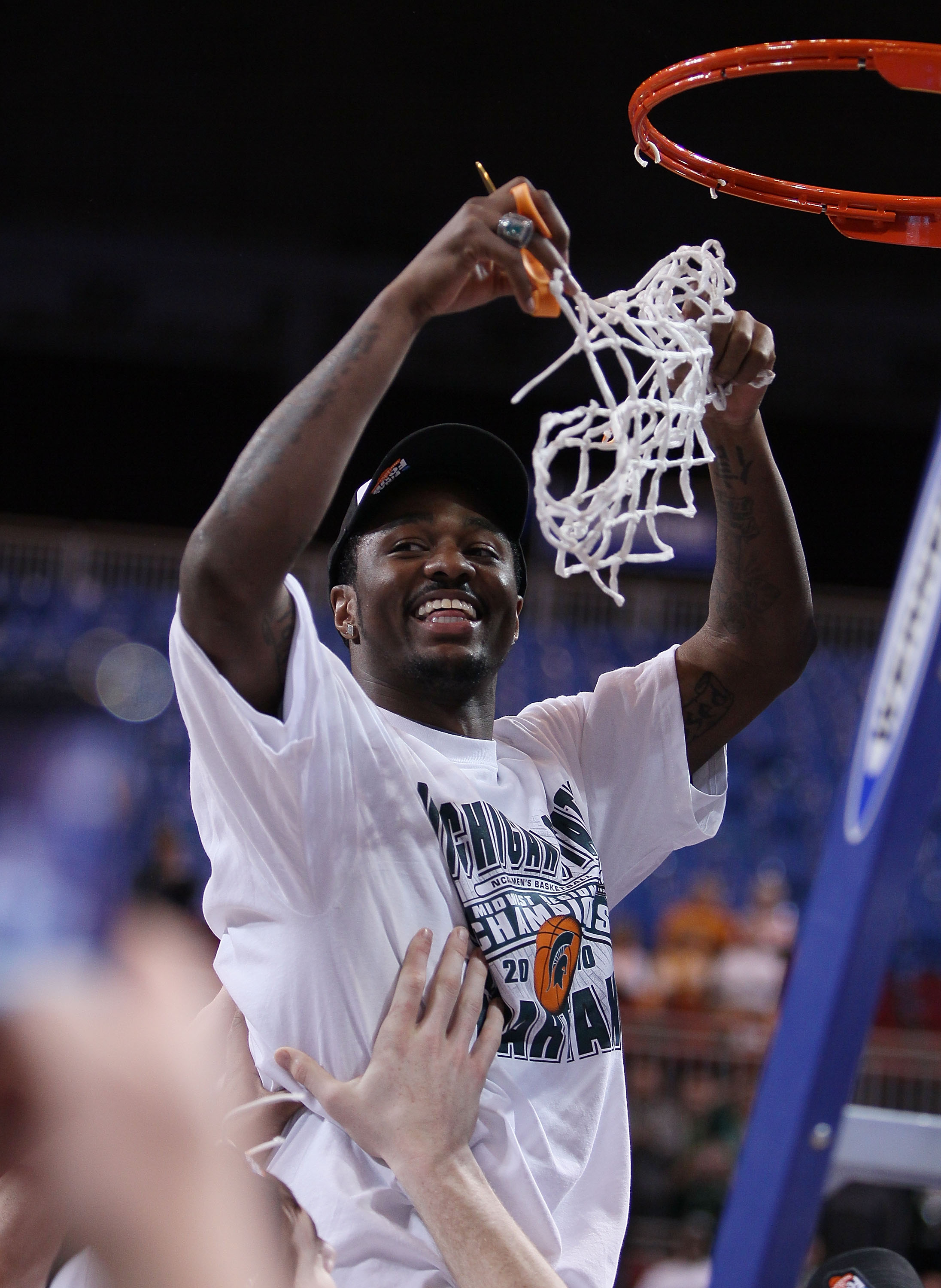 ST. LOUIS - MARCH 28:  :  :  Kalin Lucas #1 of the Michigan State Spartans is lifted by his teammates to cut the net during the midwest regional final of the 2010 NCAA men's basketball tournament at the Edward Jones Dome on March 28, 2010 in St. Louis, Mi