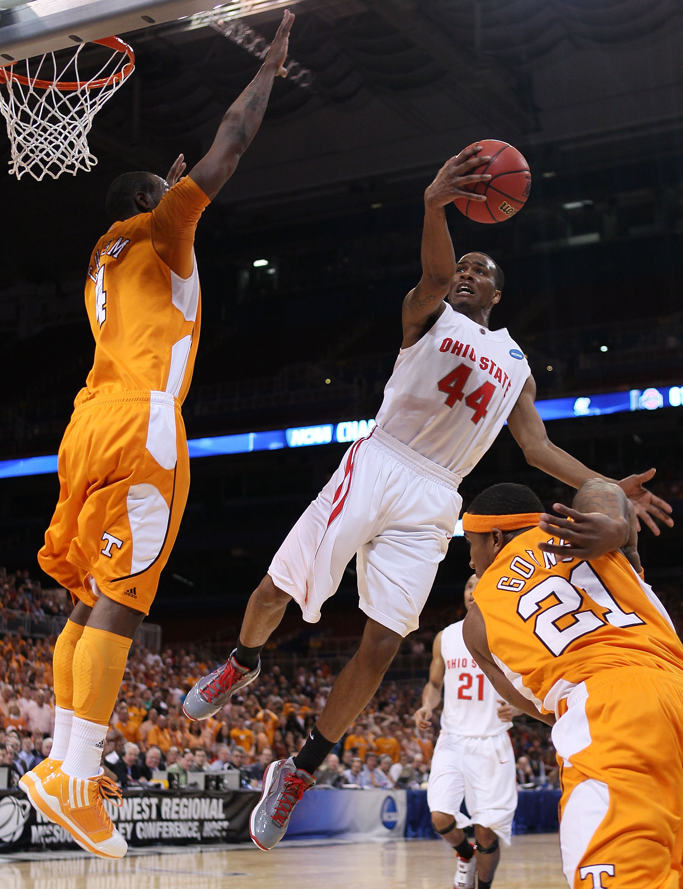 ST. LOUIS - MARCH 26:  William Buford #44 of the Ohio State Buckeyes goes up for a shot as Melvin Goins #21 and Wayne Chism #4 of the Tennessee Volunteers defend during the midwest regional semifinal of the 2010 NCAA men's basketball tournament at the Edw