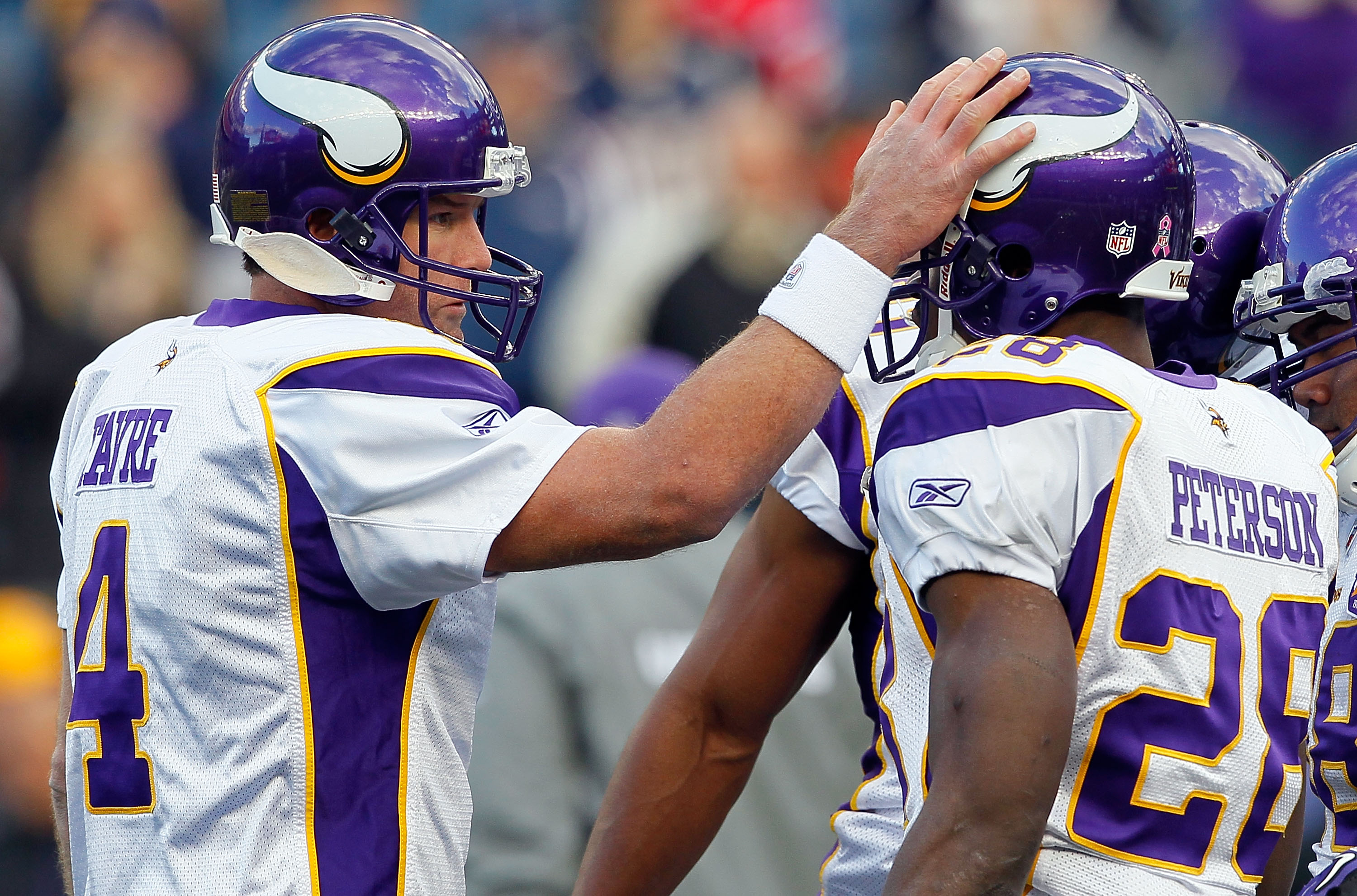 FOXBORO, MA - OCTOBER 31:  Brett Favre #4 of the Minnesota Vikings interacts with teammate Adrian Peterson #28 before a game against the New England Patriots at Gillette Stadium on October 31, 2010 in Foxboro, Massachusetts. (Photo by Jim Rogash/Getty Ima