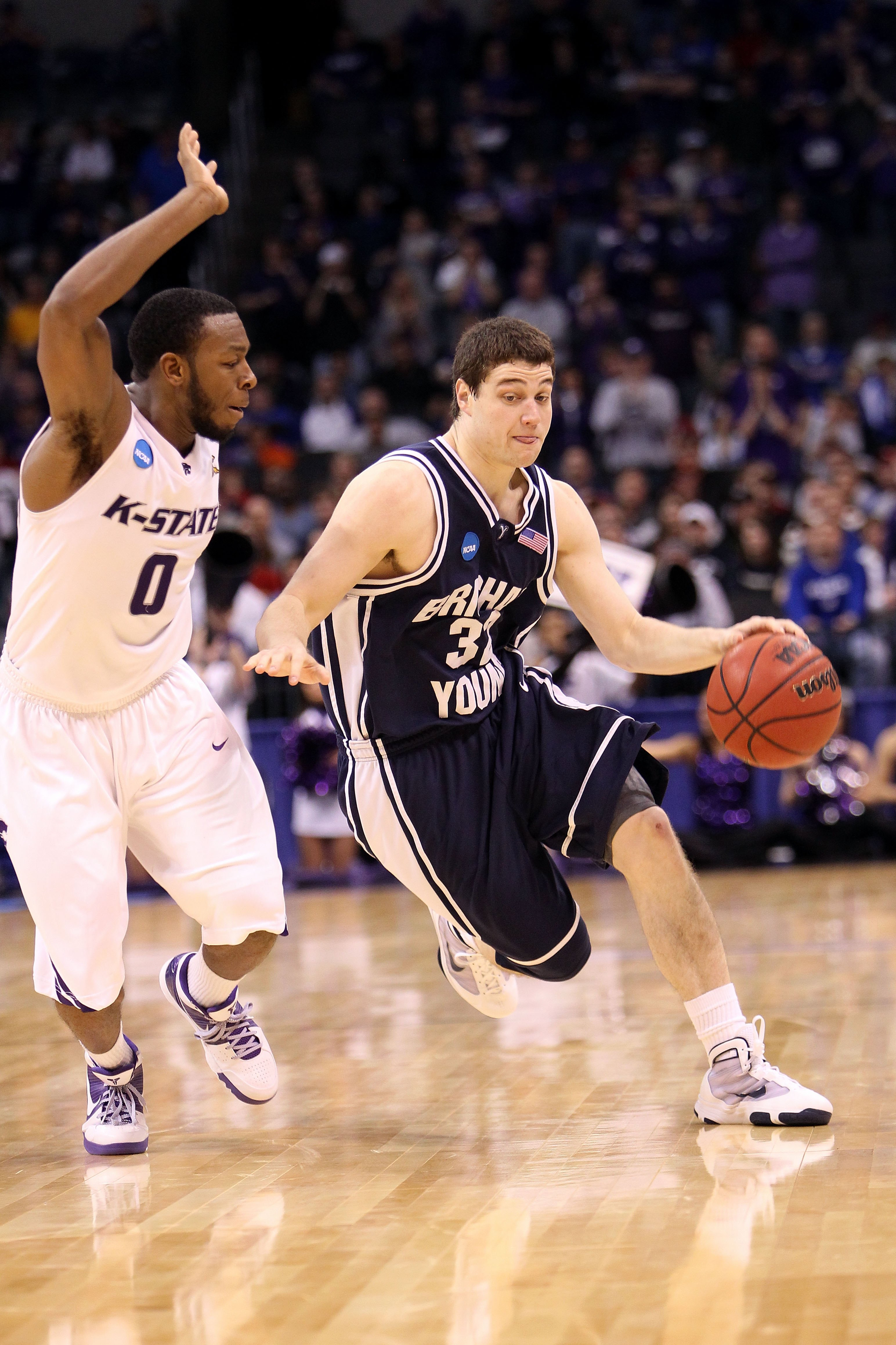 OKLAHOMA CITY - MARCH 20:  Jimmer Fredette #32 of the Brigham Young Cougars drives against Jacob Pullen #0 of the Kansas State Wildcats during the second round of the 2010 NCAA men's basketball tournament at Ford Center on March 20, 2010 in Oklahoma City,