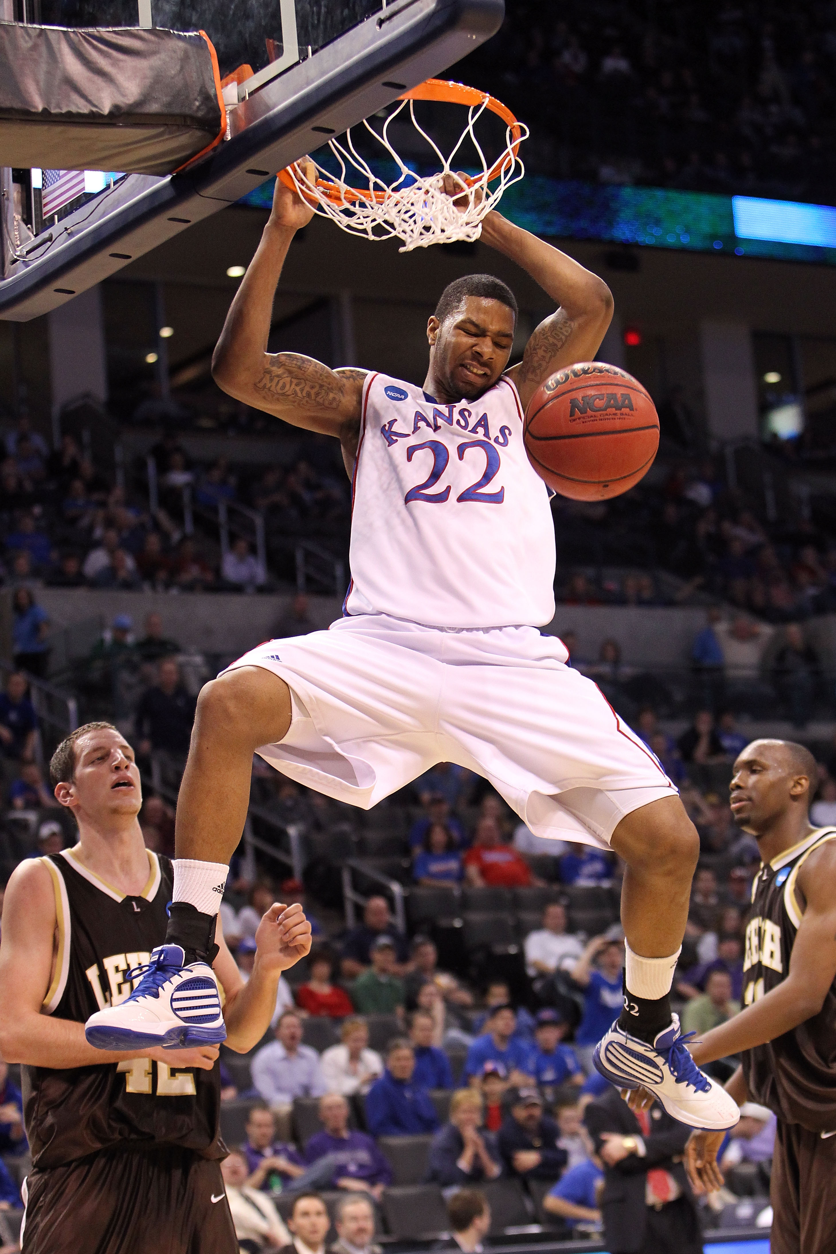 OKLAHOMA CITY - MARCH 18:  Marcus Morris #22 of the Kansas Jayhawks dunks against the Lehigh Mountain Hawks during the first round of the 2010 NCAA men's basketball tournament at Ford Center on March 18, 2010 in Oklahoma City, Oklahoma.  (Photo by Ronald