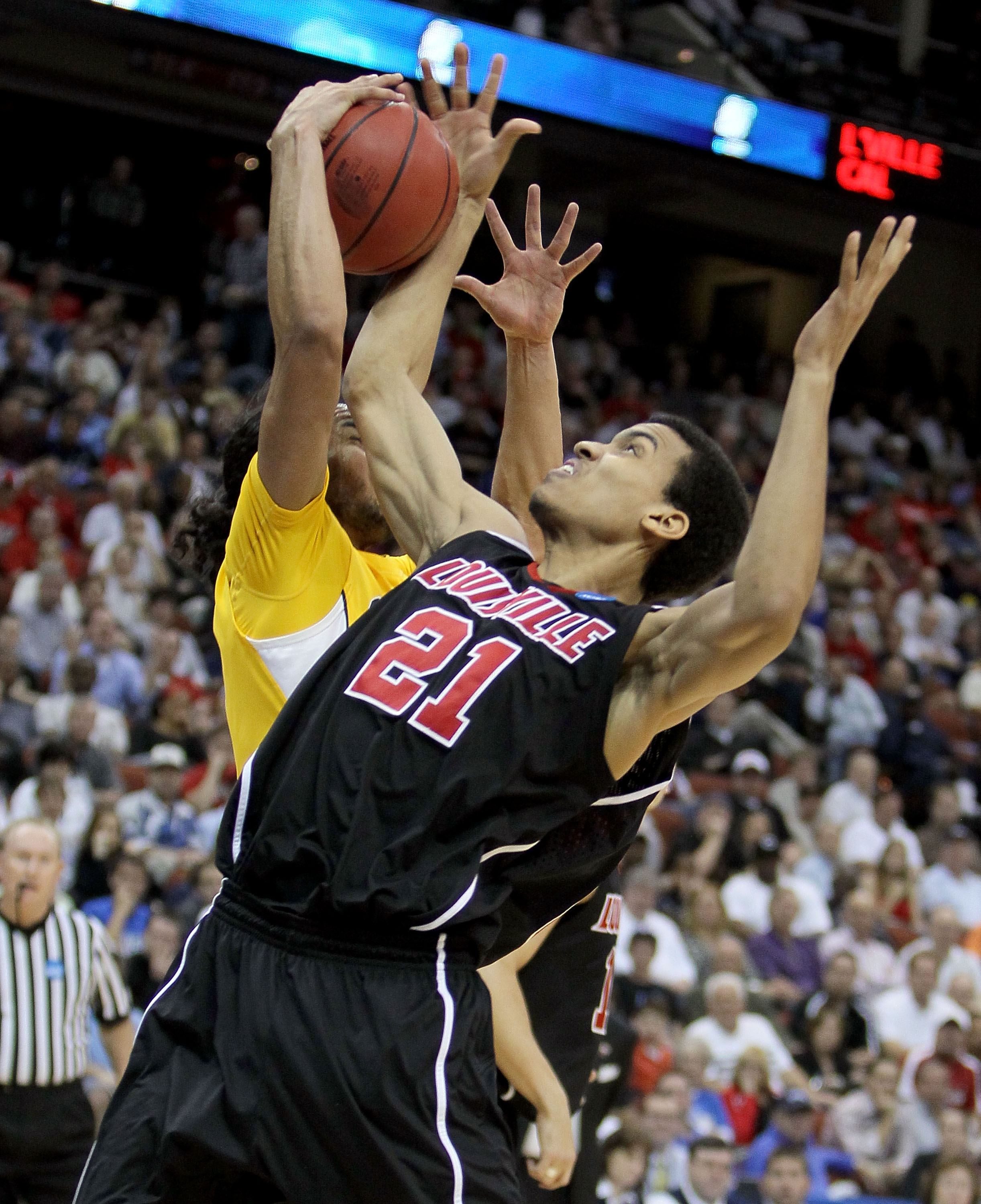 JACKSONVILLE, FL - MARCH 19: Jared Swopshire #21 of the Louisville Cardinals battles with Jorge Gutierrez #2 of the California Golden Bears during the first round of the 2010 NCAA men's basketball tournament at Jacksonville Veteran's Memorial Arena on Mar