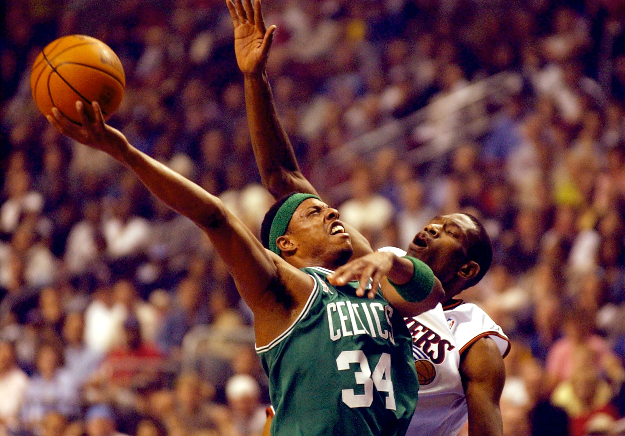 PHILADELPHIA-MAY 1: Paul Pierce #34 of the Boston Celtics looses control of a shot under the defense of Dikembe Mutombo #55 of the Philadelphia 76ers during game 4 of the Eastern Conference quarterfinal series during the 2002 NBA Playoffs at the First Uni