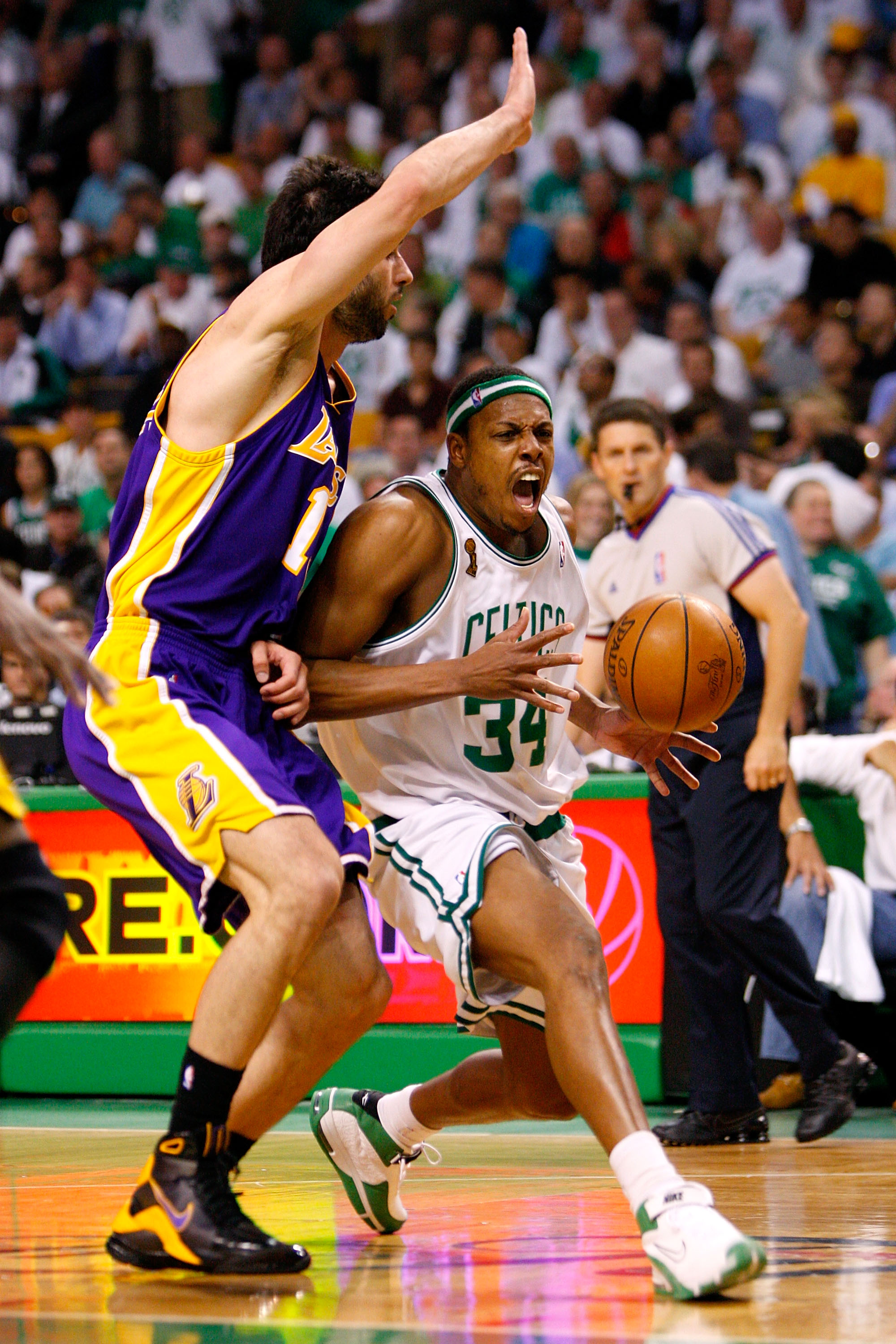 BOSTON - JUNE 05:  Paul Pierce #34 of the Boston Celtics drives to the basket against Vladimir Radmanovic #10 of the Los Angeles Lakers in Game One of the 2008 NBA Finals on June 5, 2008 at TD Banknorth Garden in Boston, Massachusetts. NOTE TO USER: User
