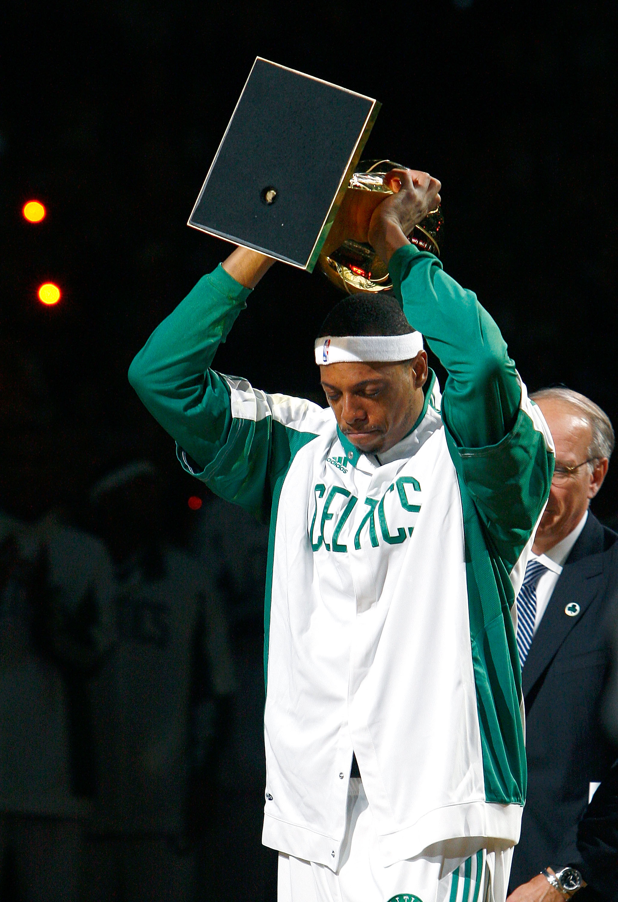 BOSTON, MA - OCTOBER 28: Paul Pierce #34 of the Boston Celtics raise the 2008 World Championship trophy during the 2008 NBA World Championship ceremony before a game against the Cleveland Cavaliersat the TD Banknorth Garden on October 28, 2008 in Boston,