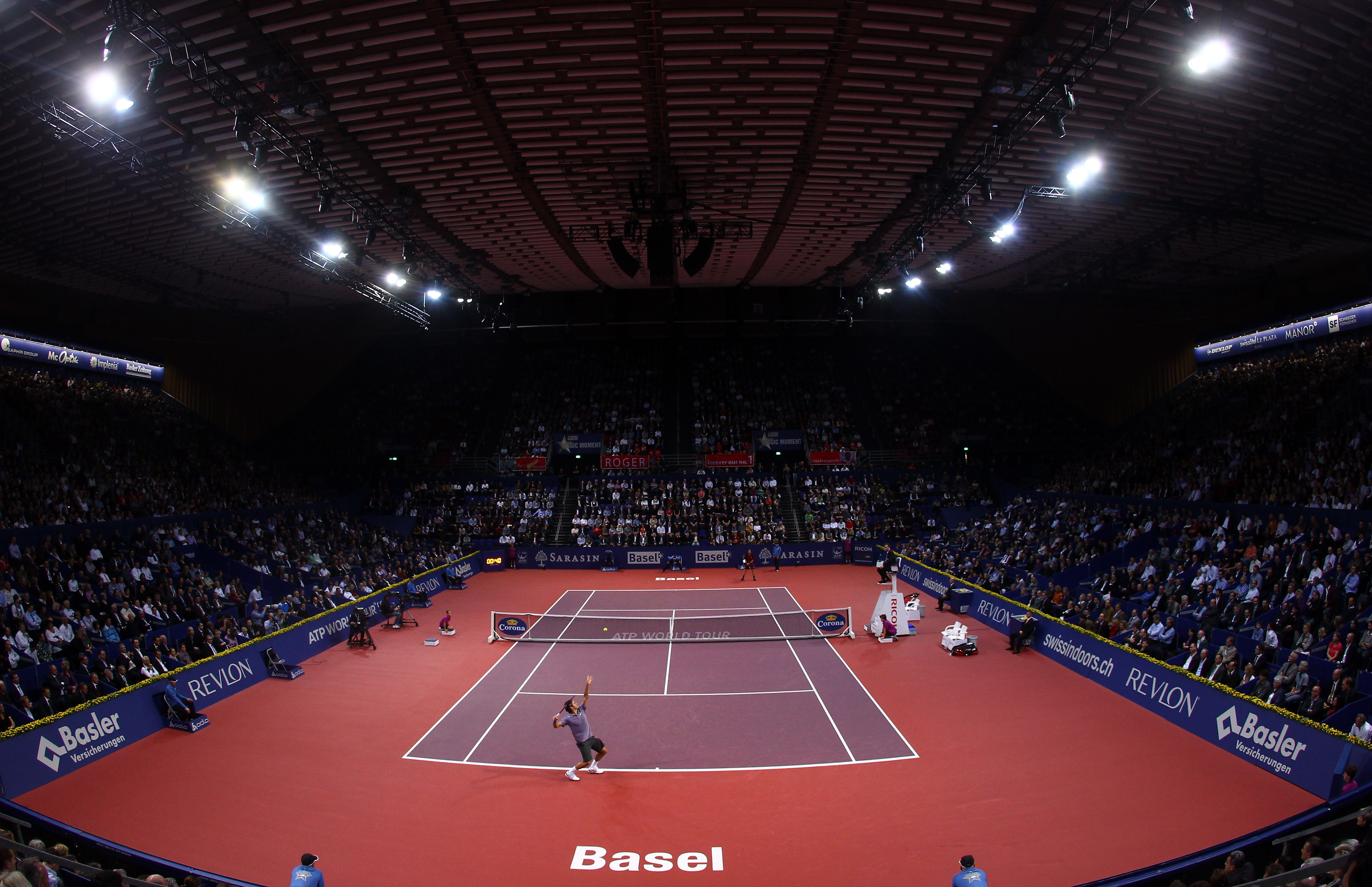 BASEL, SWITZERLAND - NOVEMBER 03:  A general view of Roger Federer of Switzerland serving to Janko Tipsarevic of Serbia during Day Three of the Davidoff Swiss Indoors Tennis at St Jakobshalle on November 3, 2010 in Basel, Switzerland.  (Photo by Julian Fi