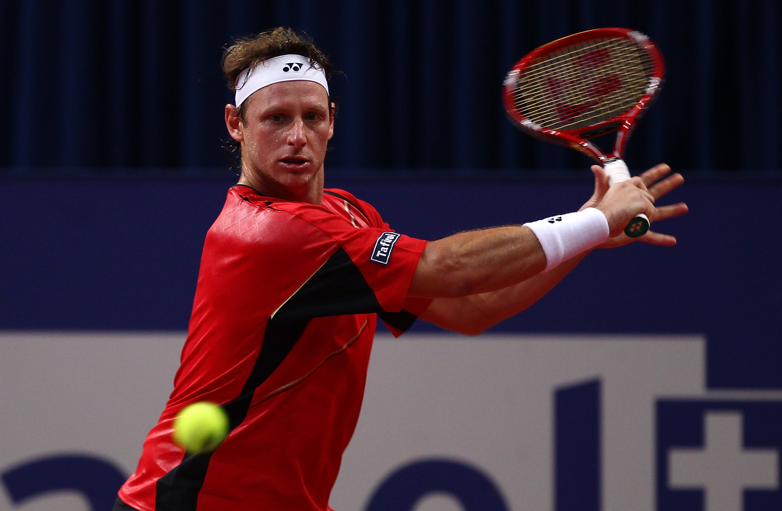 BASEL, SWITZERLAND - NOVEMBER 04:  David Nalbandian of Argentina in action in his match against Marin Cilic of Croatia during Day Four of the Davidoff Swiss Indoors Tennis at St Jakobshalle on November 4, 2010 in Basel, Switzerland.  (Photo by Julian Finn