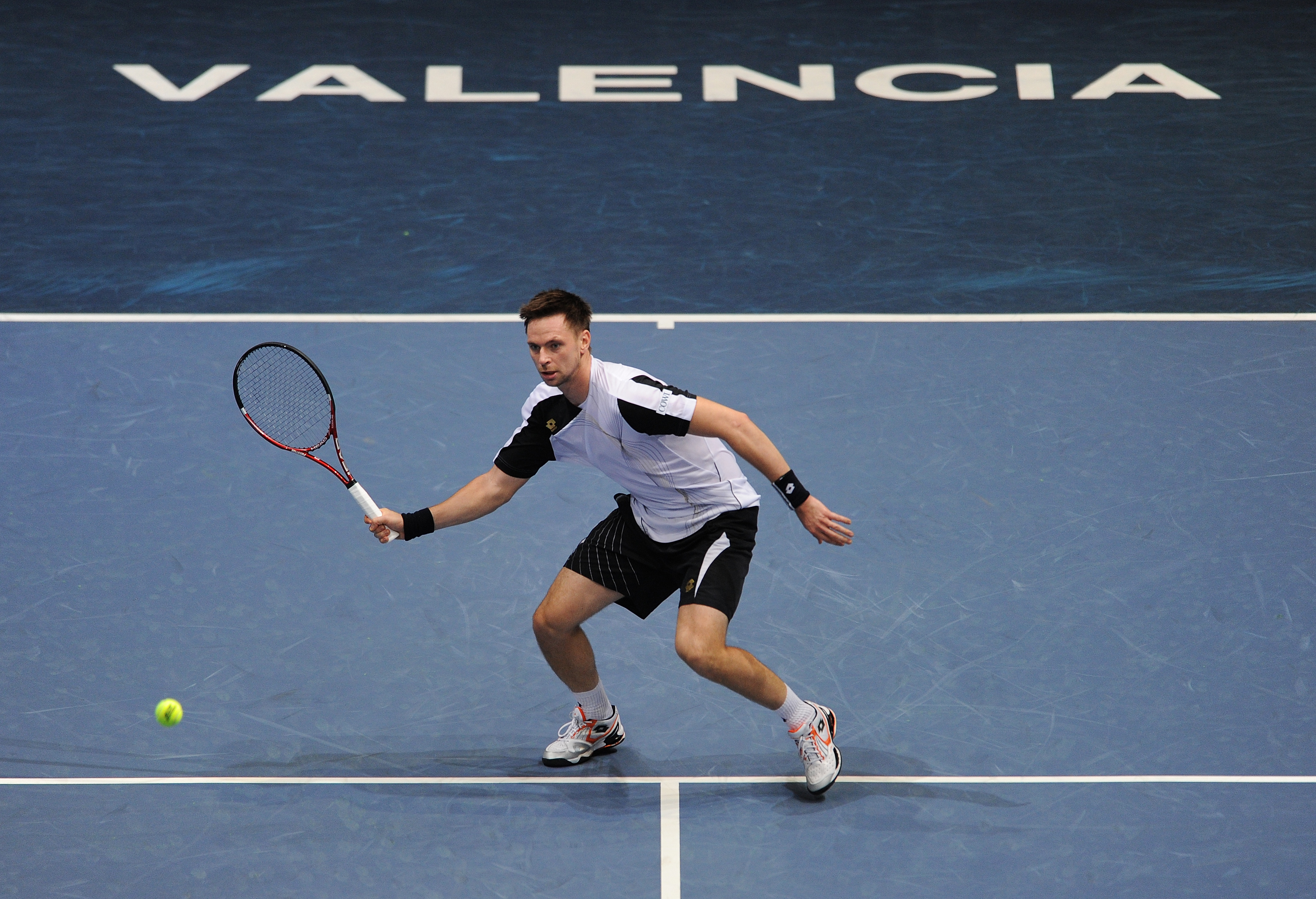 VALENCIA, SPAIN - NOVEMBER 02:  Robin Soderling of Sweden plays a backhand to Albert Montanes of Spain in his first round match during the ATP 500 World Tour Valencia Open tennis tournament at the Ciudad de las Artes y las Ciencias on November 2, 2010 in