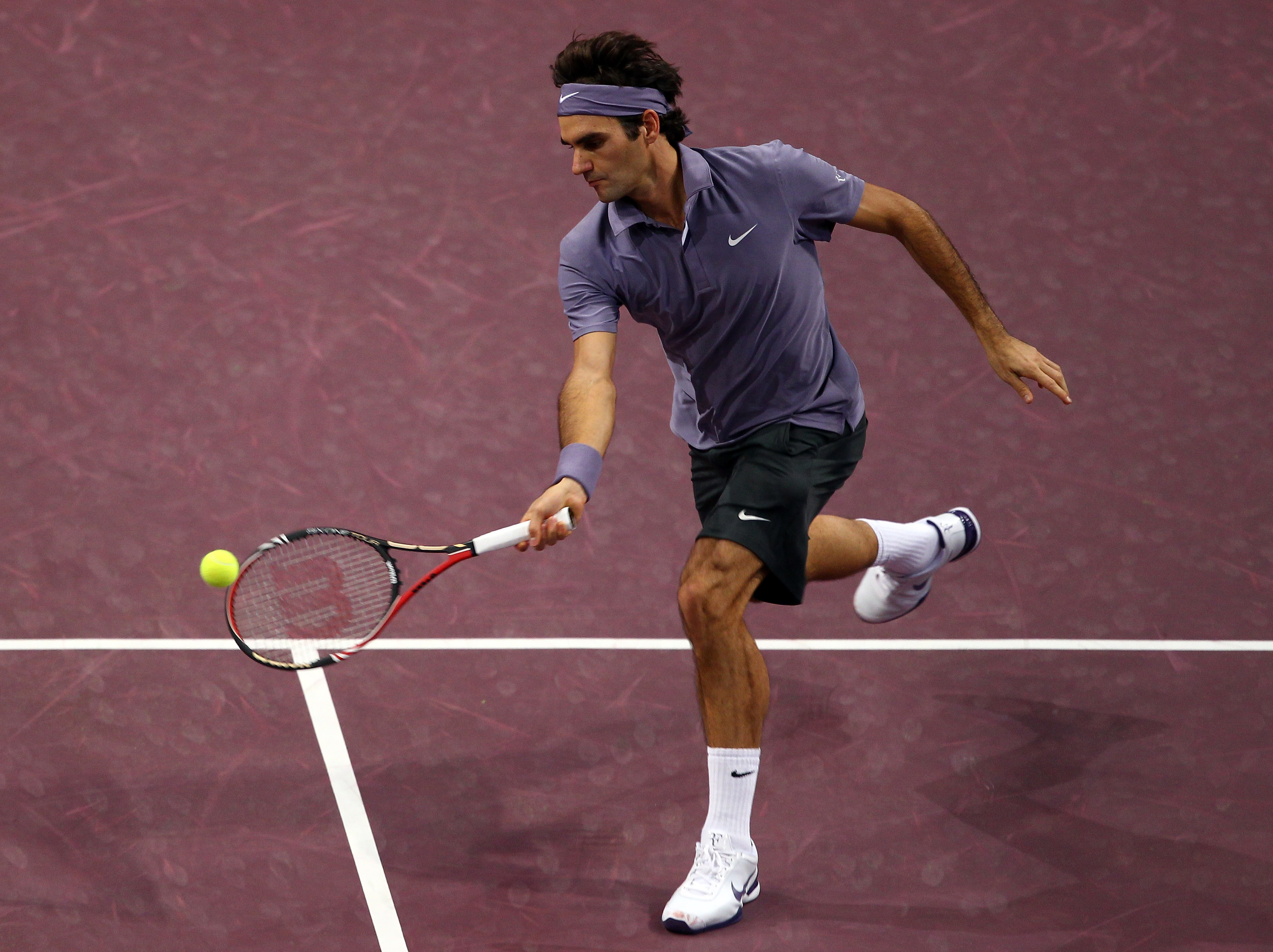 BASEL, SWITZERLAND - NOVEMBER 03:  Roger Federer of Switzerland plays a volley in his match against Janko Tipsarevic of Serbia during Day Three of the Davidoff Swiss Indoors Tennis at St Jakobshalle on November 3, 2010 in Basel, Switzerland.  (Photo by Ju