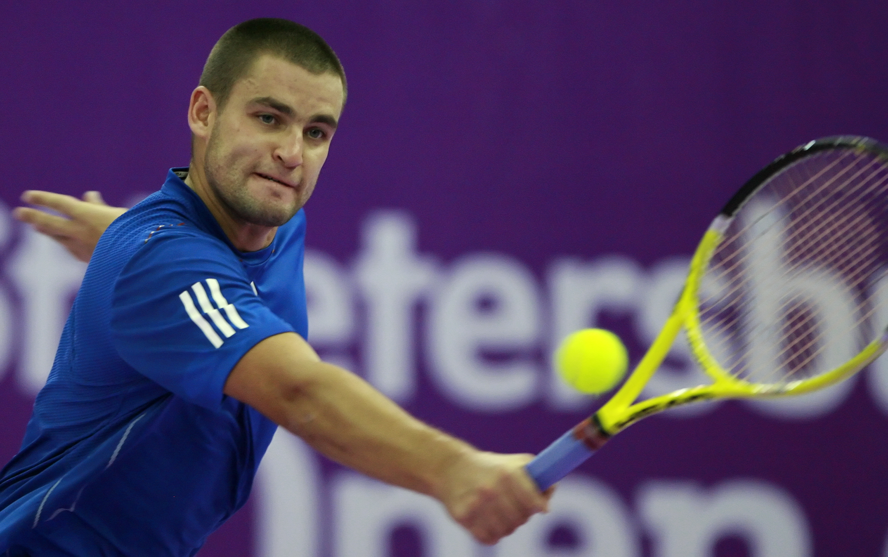 ST. PETERSBURG, RUSSIA - OCTOBER 31: Mikhail Youzhny of Russia plays against Mikhail Kukushkin of Kazakhstan during the singles final of the International Tennis Tournamen St. Petersburg Open 2010 at the Petersburgsky Sports Complex on October 31, 2010 in