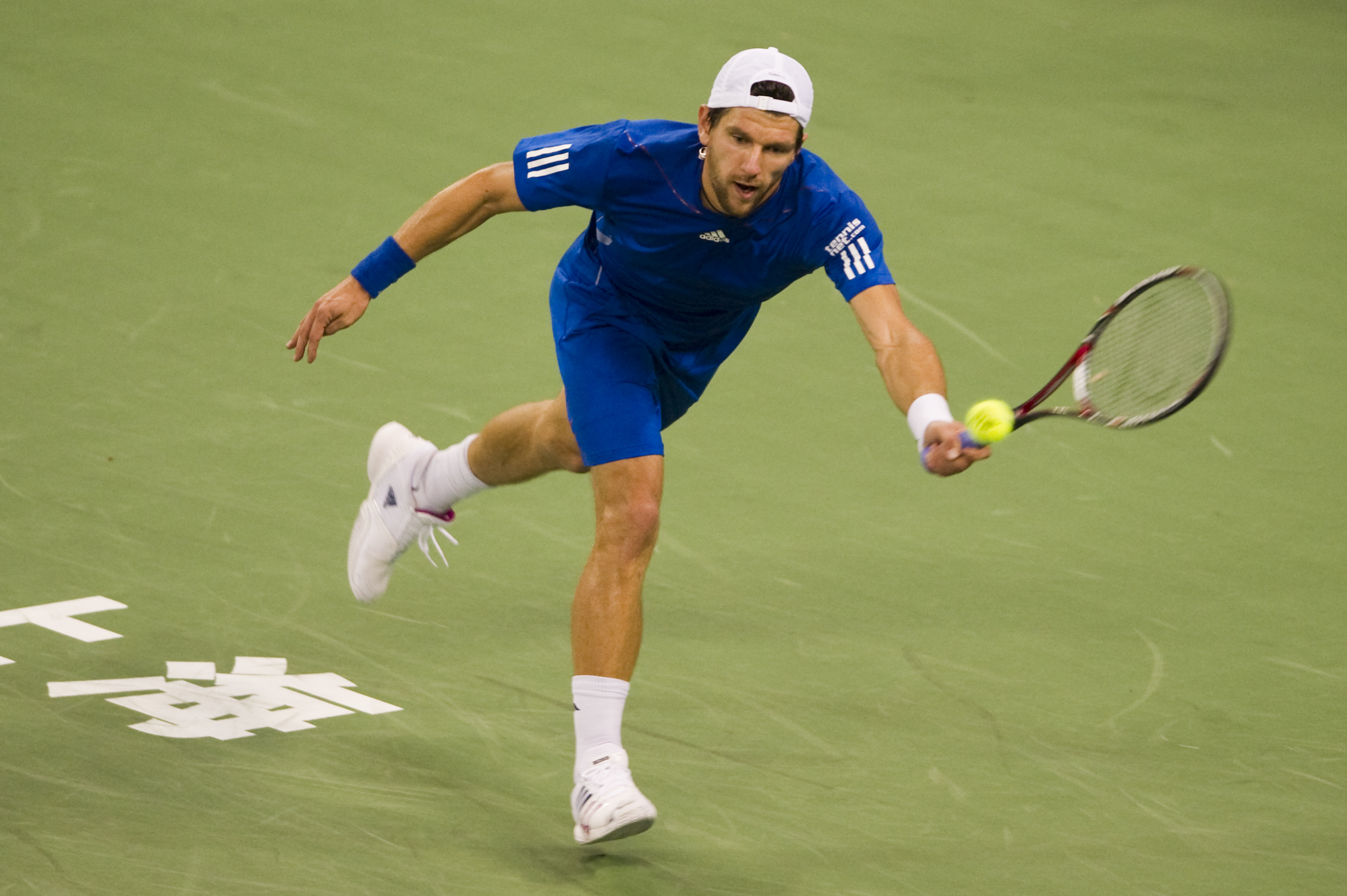 SHANGHAI, CHINA - OCTOBER 15:  Jurgen Melzer of Austria returns a ball to Juan Monaco of Argentina during day five of the 2010 Shanghai Rolex Masters at the Shanghai Qi Zhong Tennis Center on October 15, 2010 in Shanghai, China.  (Photo by Victor Fraile/G