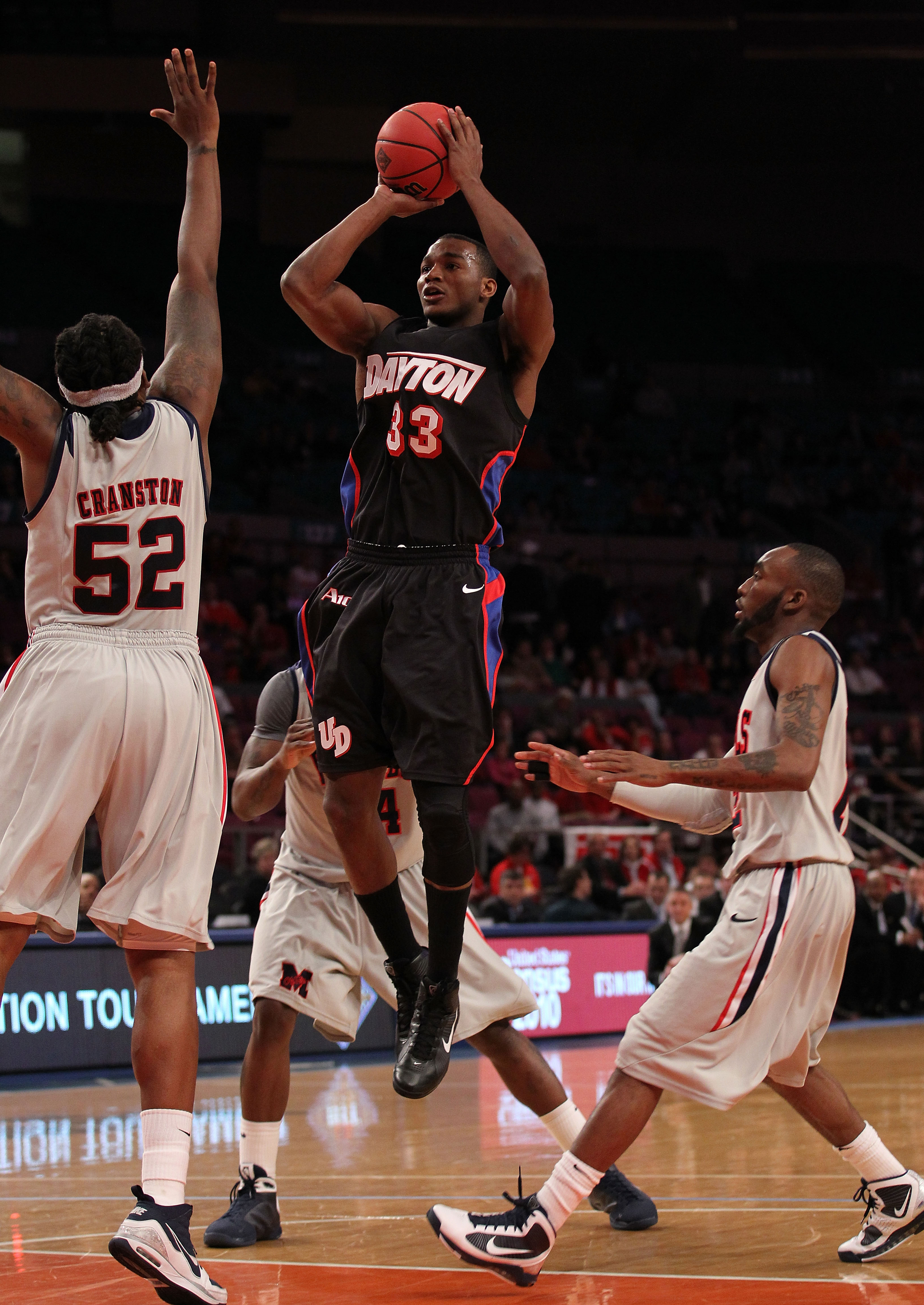 NEW YORK - MARCH 30:  Chris Wright #33 of the Dayton Flyers shoots a shot over DeAundre Cranston #52 of Ole Miss during their semi final at Madison Square Garden on March 30, 2010 in New York, New York.  (Photo by Nick Laham/Getty Images)