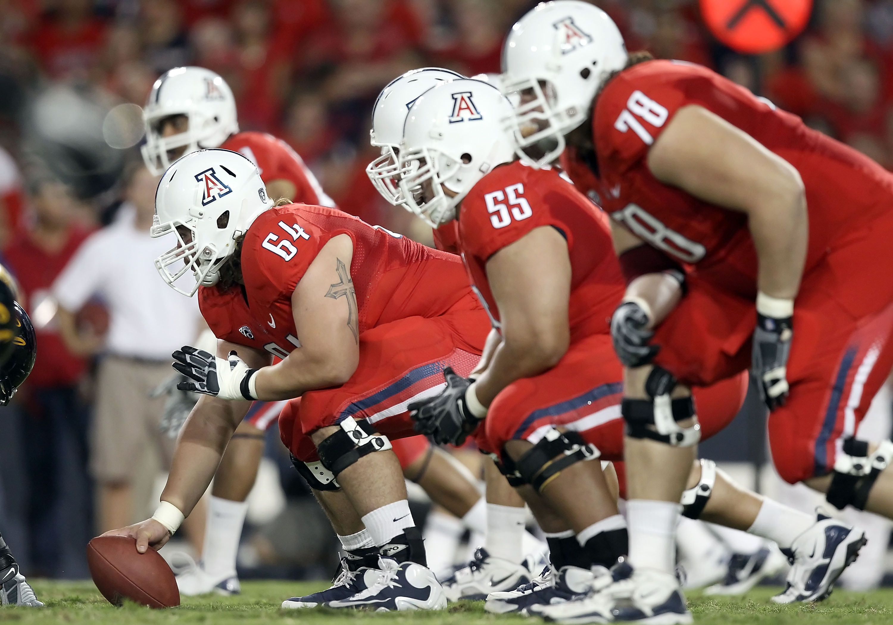 TUCSON, AZ - SEPTEMBER 25:  Center Colin Baxter #64 of the Arizona Wildcats prepares to snap the ball during the college football game against the California Golden Bears at Arizona Stadium on September 25, 2010 in Tucson, Arizona.   The Wildcats defeated