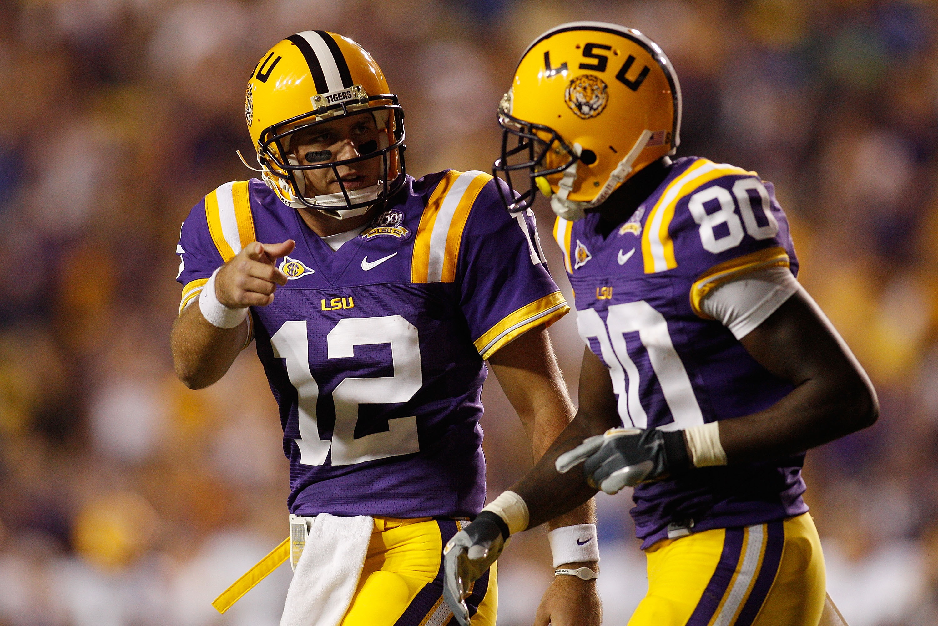 BATON ROUGE, LA - OCTOBER 16:  Jarrett Lee #12 talks with Terrence Toliver #80 of the Louisiana State University Tigers after a touchdown during the game against the McNeese State Cowboys at Tiger Stadium on October 16, 2010 in Baton Rouge, Louisiana.  (P