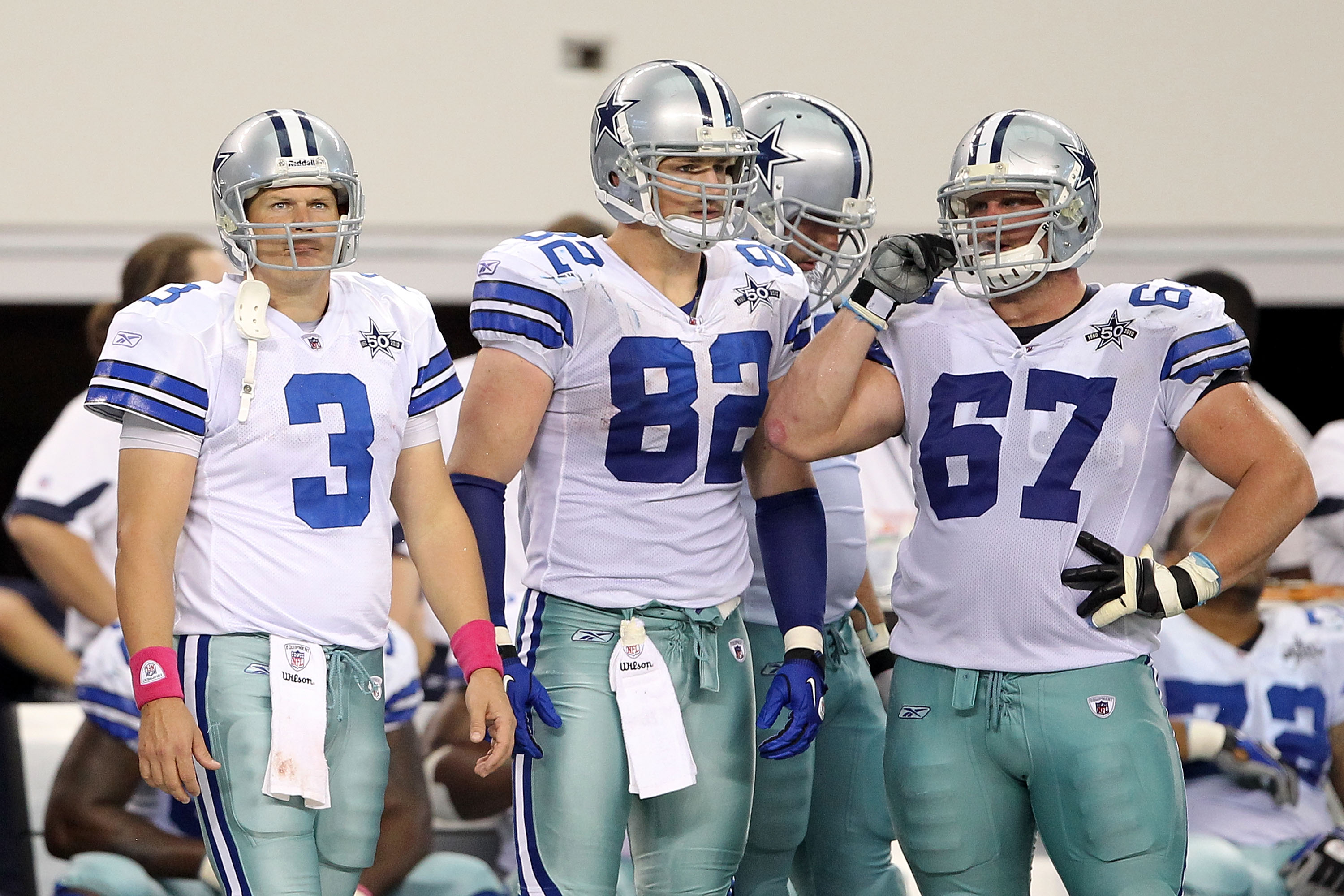 ARLINGTON, TX - OCTOBER 31:  (L-R) Jon Kitna #3, Jason Witten #82 and Phil Costa #67 of the Dallas Cowboys look on from the sideline late in the fourth quarter against the Jacksonville Jaguars at Cowboys Stadium on October 31, 2010 in Arlington, Texas.  (