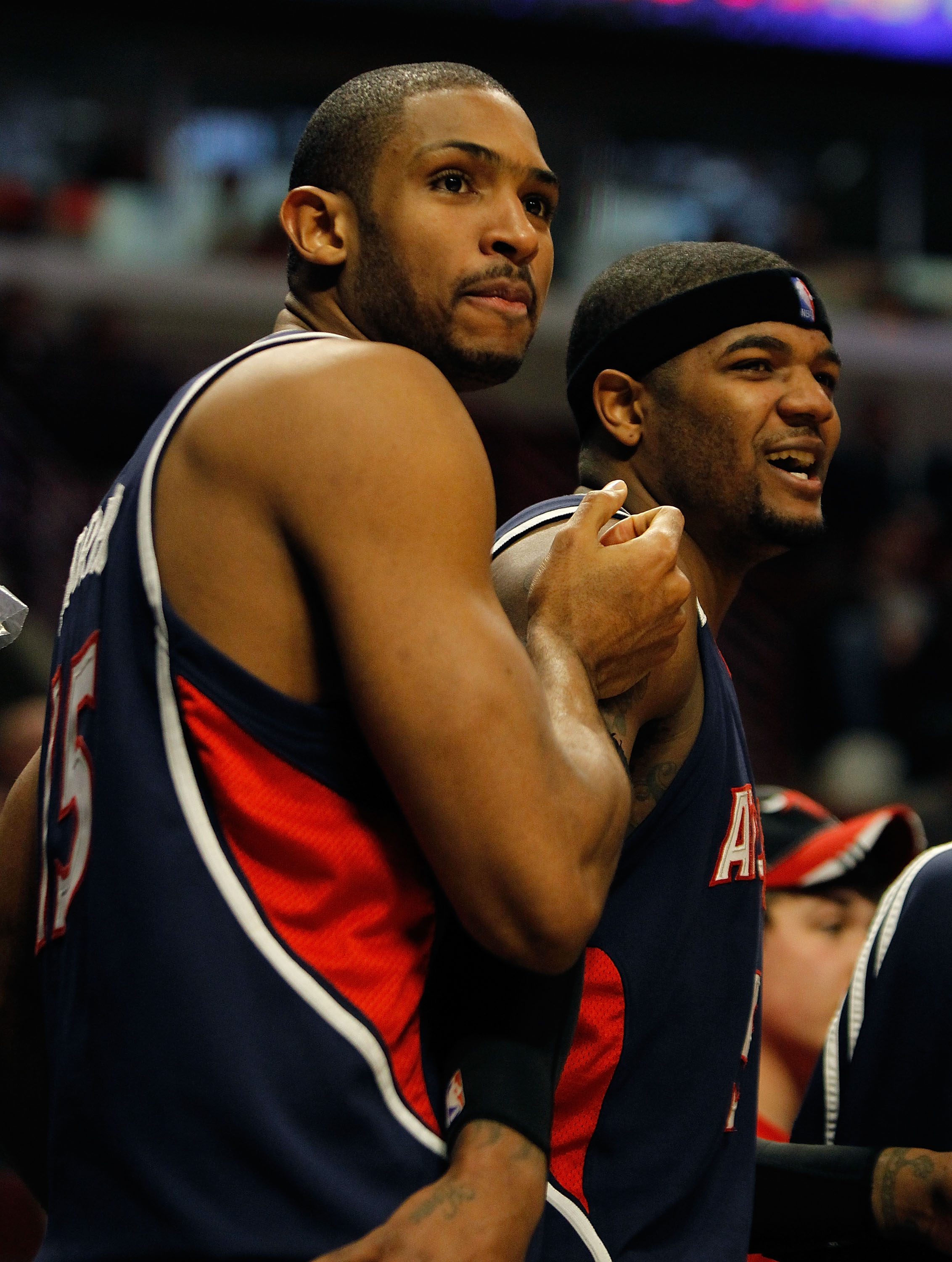 CHICAGO - MARCH 01: Al Horford #15 and Josh Smith #5 of the Atlanta Hawks react during the final minute of a win over the Chicago Bulls at the United Center on March 1, 2010 in Chicago, Illinois. The Hawks defeated the Bulls 116-92. NOTE TO USER: User exp