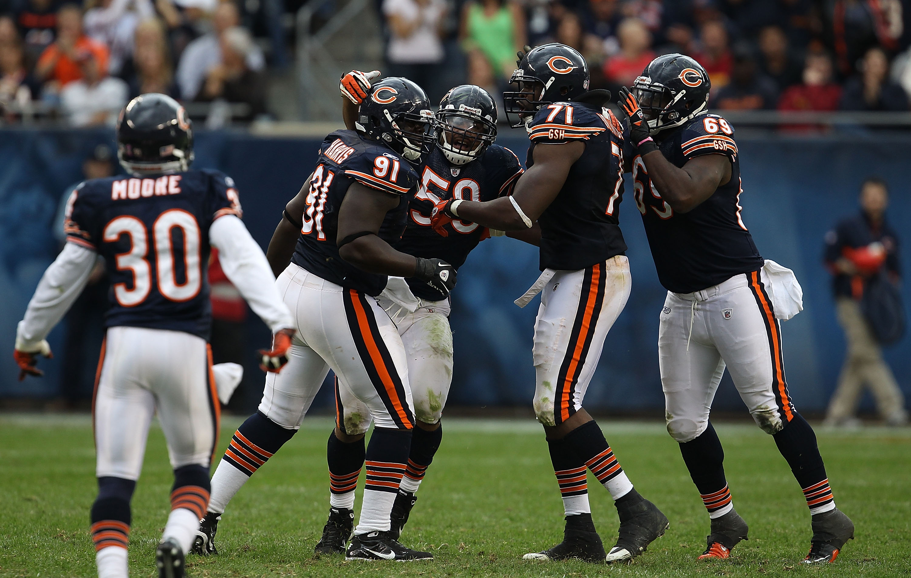 CHICAGO - OCTOBER 24: (L-R) D.J. Moore #30, Tommie Harris #91, Rod Wilson #58, Israel Idonije #71 and Henry Melton #69 of the Chicago Bears celebrate a defensive stop against the Washington Redskins at Soldier Field on October 24, 2010 in Chicago, Illinoi