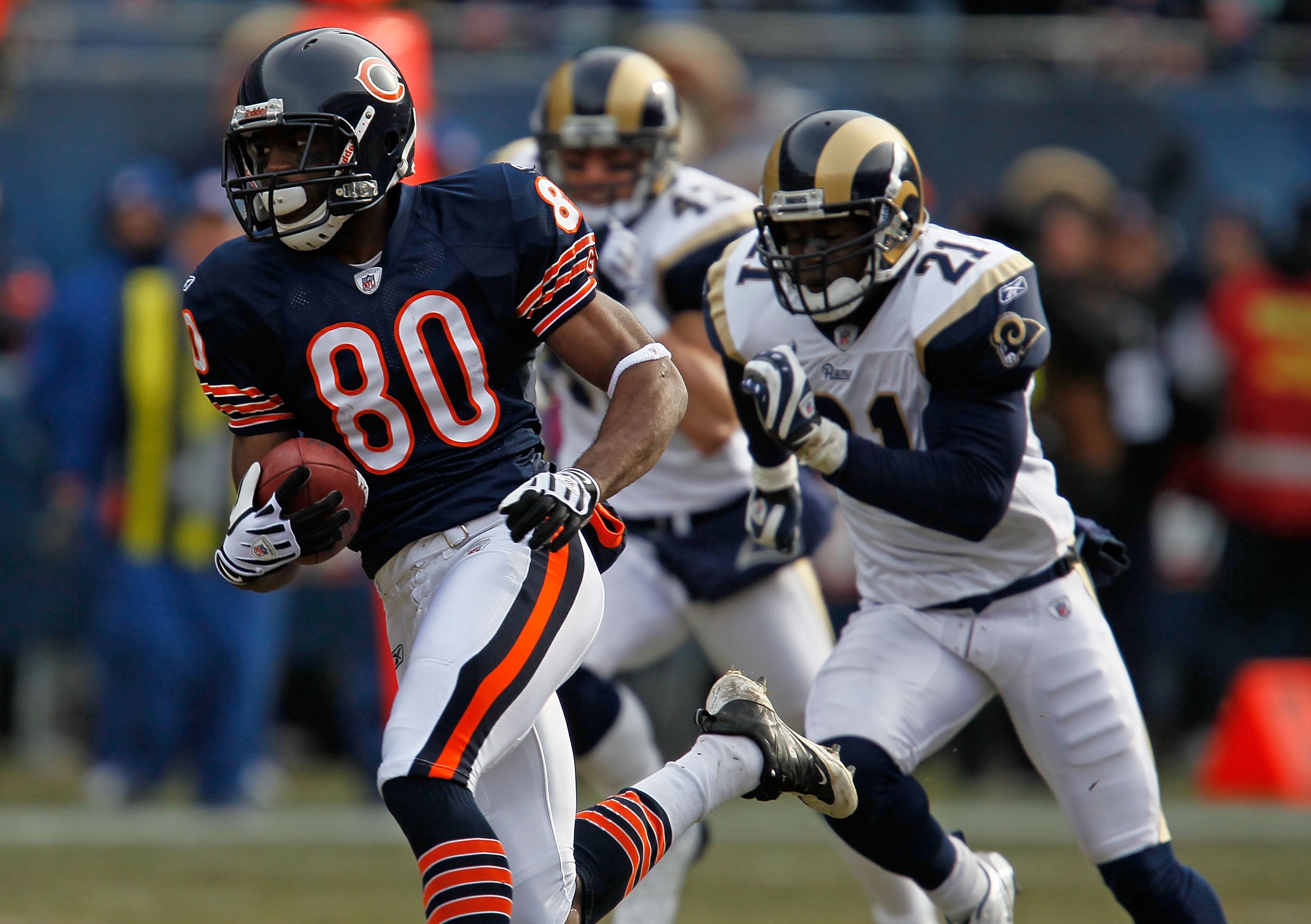 CHICAGO - DECEMBER 06:  Earl Bennett #80 of the Chicago Bears breaks for a long run and is chased by (L-R) Craig Dahl #43 and Oshiomogho Atogwe of the St. Louis Rams at Soldier Field on December 6, 2009 in Chicago, Illinois. The Bears defeated the Rams 17