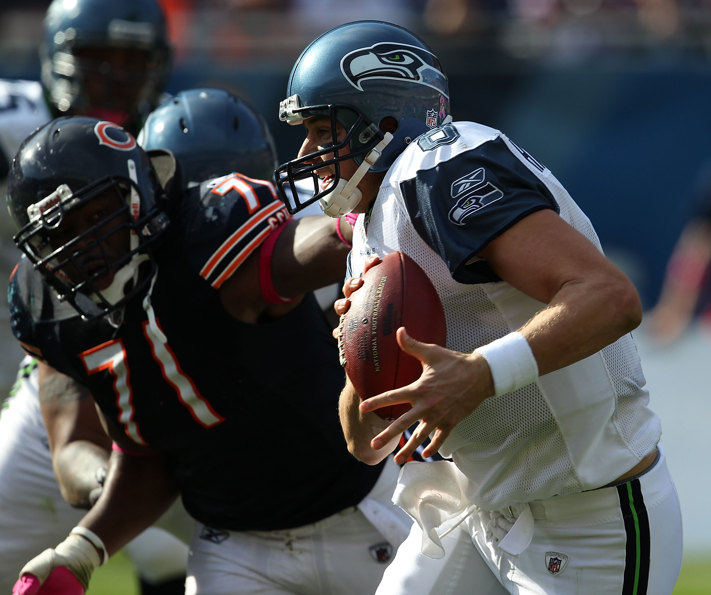 CHICAGO - OCTOBER 17: Matt Hasselbeck #8 of the Seattle Seahawks runs past Israel Idonije #71 of the Chicago Bears at Soldier Field on October 17, 2010 in Chicago, Illinois. The Seahawks defeated the Bears 23-20. (Photo by Jonathan Daniel/Getty Images)